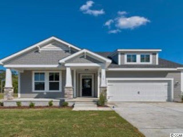 To be built home.  Picture is of model home in Champions Village which is the same floor plan and elevation.