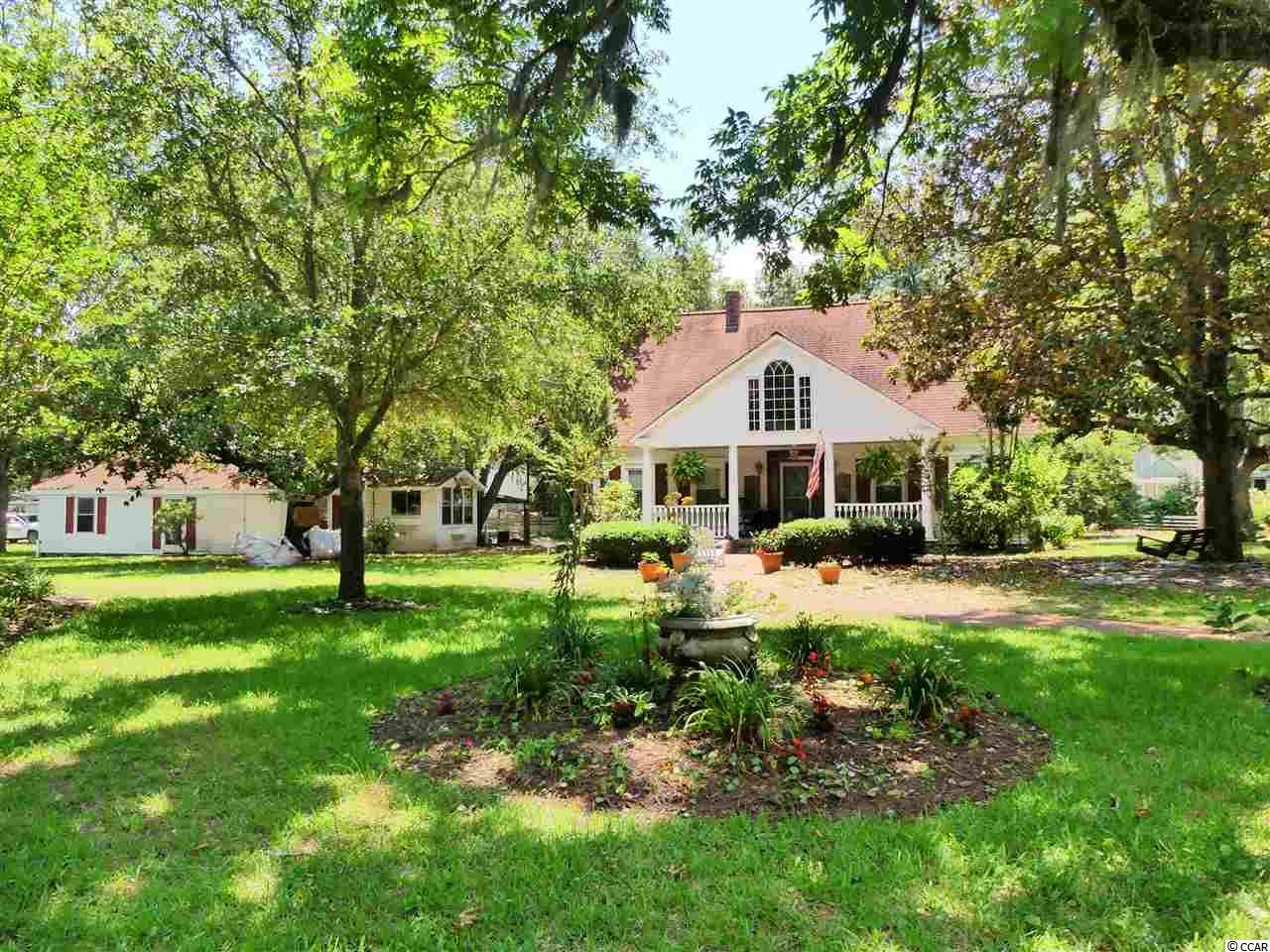 Historic Elegance in the heart of Murrells Inlet, SC! This southern masterpiece built in the late 1800s and officially recorded at the court house in 1902 is perhaps one of the first homes ever built in the old historic fishing village of Murrells Inlet. The charming home at 4400 Murrells Inlet Road boasts over 2,200 square feet of living space and is situated on what is quite possibly one of the largest remaining lots in 'The Inlet' (east of ocean highway) totaling 1.26 acres. Although this historic home was built over 100 years ago, it has been consistently upgraded over the years without losing its unique historic appeal. Some of the upgrades and unique features include civil war era wood beam, stained glass accents, custom copper ceiling, antique transoms from England, and so much more. The kitchen has been updated with modern touches such as an upscale Viking range and Bosch Dishwasher. The kitchen seamlessly flows into the dining area overlooking the living room and spacious sitting area extending out to a spacious screened porch. Immerse yourself in the park-like setting you will soon call home. *** Please Ask Your Realtor for a detailed history of the property *** MORE INFORMATION AVAILABLE THAT'S NOT LISTED ON THE MLS ***