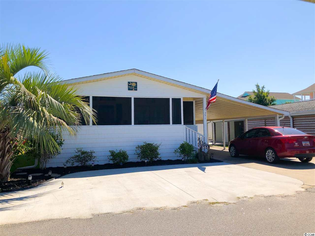 Absolutely immaculate raised beach home in the much desired Oceanside Village. Golf cart ride to a gated beach parking lot next door to the oceanfront Conch Cafe! Large screened porch, new furniture, new washer and dryer, new microwave, new storm window inserts, new insulation in crawl space. New EcoBee thermostat that can be controlled by your phone.   Oceanside Village has two outdoor pools, a Splash Pad for the kids, hot tub, indoor pool, library, fitness center, ponds, dog park, lots of nature and green areas. The Amenities Center is the heart of the village, with a commercial kitchen, stage, dance floor for dinners, dances, and game nights. Also, you can enjoy tennis, baseball, bocce ball, soccer, a playground, and more. Enjoy the lifestyle of living in an oceanside neighborhood.