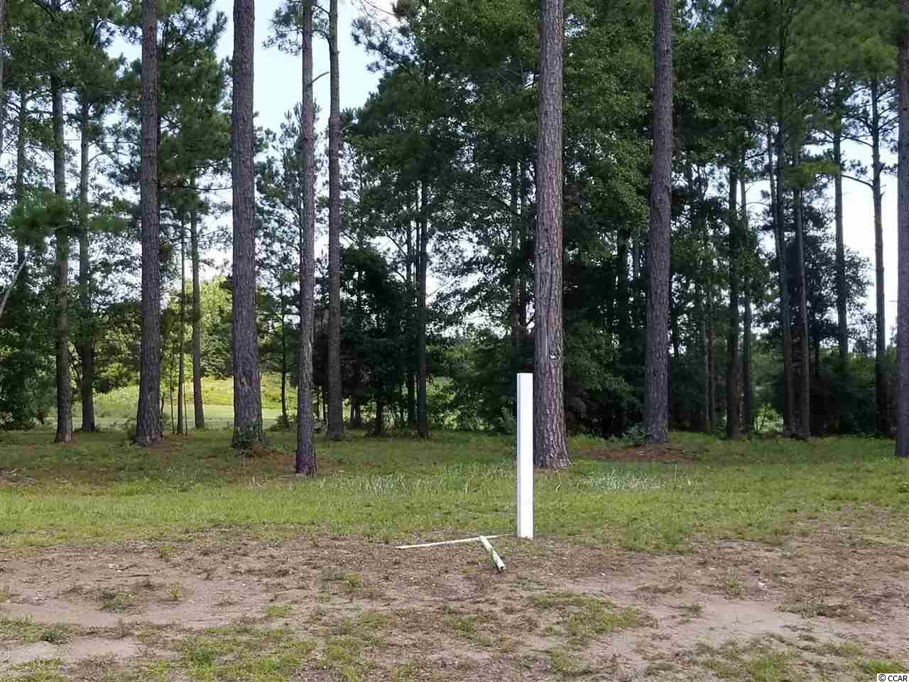 Beautiful .5 acre home site with amazing views of the green and fairway on the first hole on the famed Members Course. This tranquil setting is the perfect place to build your dream home. This property is located in South Carolina's premier coastal community in Myrtle Beach; Grande Dunes.  Stretching from the Ocean to the Carolina Bays Preserve, this 2200 acre development is amenity-rich and filled with lifestyle opportunities unrivaled in the market.  Owners at Grande Dunes enjoy a 25,000 square foot Ocean Club that boasts exquisite dining, oceanfront pools with food & beverage service, along with meeting rooms and fun activities.  Additionally, the community has two 18-hole golf courses, including the area's only truly private course designed by Nick Price, along with several on-site restaurants, deep water marina, Har-tru tennis facility and miles or biking/walking trails!  Please visit our sales gallery located in Grande Dunes Marketplace next to Lowes Foods to learn more about this amazing community you can call home.