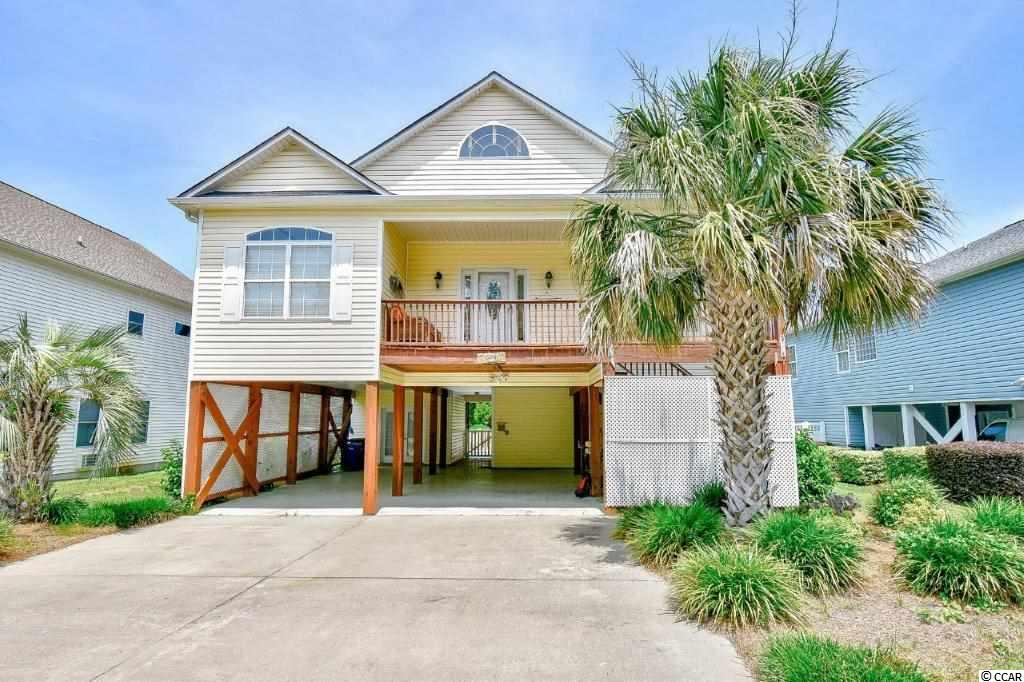 Incredible value for this North Myrtle Beach Retreat. The perfect location for your primary or secondary home away from Ocean Boulevard, yet this home has an incredible rental history with it's flexible living space and private back yard pool.  Sellers have maximized the income on this property while maintaining less wear and tear by screening and managing the rentals themselves. Fantastic fully furnished 4 bedroom 4 bath home located in the Crescent Beach section of North Myrtle Beach. Beautifully maintained and walking distance to the beach. This raised beach style home includes plenty of parking, a fenced in backyard with pool and patio area! Upstairs, you will find the main living areas offer an open floor plan with beautiful wood flooring throughout. The kitchen is equipped with all appliances and a large breakfast bar. Each bedroom features a ceiling fan, plenty of closet space, and easy access to a bathroom. Enjoy your afternoons in your private pool, or at the beach just a short walk or golf cart ride away! Perfectly situated in the heart of North Myrtle Beach, near all of the Grand Strand's finest dining, shopping, golf, and entertainment attractions. Whether you are looking for an investment opportunity or your forever home, you won't want to miss this.