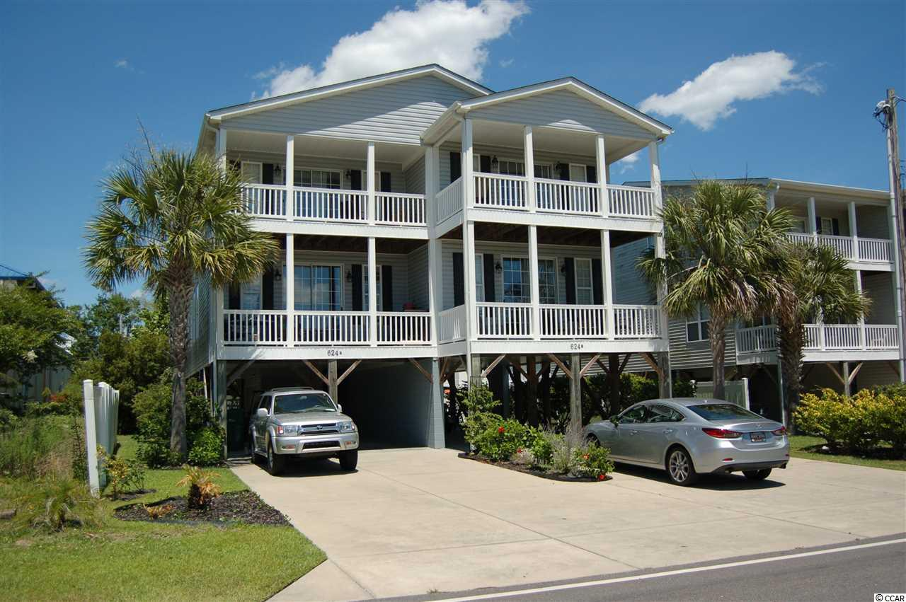 This raised beach duplex (Unit A) is a fully furnished 5 bedrooms, 4 baths property located in Garden City Beach. Enjoy a walk to the beach, people watching from one of two balconies or cool off in the outdoor pool. This duplex is located in a prime rental area so you have the value of ownership while the short term tenants make most of your payments plus there's no HOA fees. This semi-detached unit is an HPR. (Unit B is also for sale MLS #1905189)