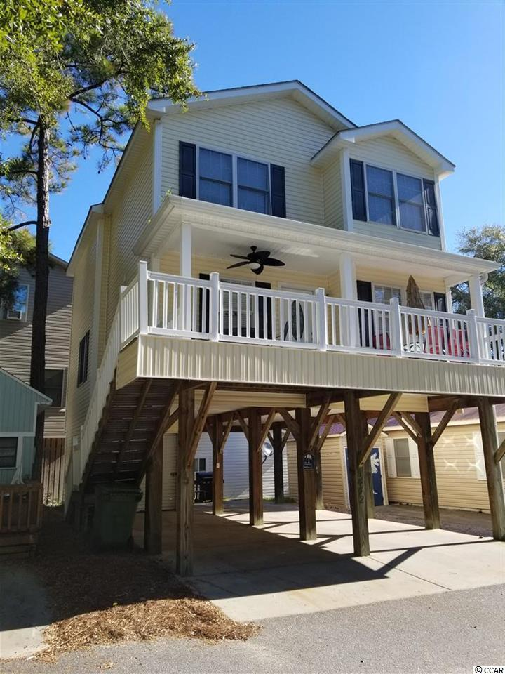 Fabulous fully furnished 5 bedroom and 3.5 bath home located in the award winning Ocean Lakes. You are sure to love the layout of this home. The downstairs features the living room, dining area, kitchen, master bedroom, master bath and laundry room. The upstairs has 4 bedrooms and 2 full bath rooms. The deck is 10 feet x 23 and 7 x 23 is covered to help protect you from the elements. There is a 9 x 15 attached shed for golf cart and beach belongings storage. You will also find an outdoor shower complete with hot and cold water. This home would make for a great primary residence or vacation rental. Are you familiar with Ocean Lakes? Ocean Lakes is a 300 acre ocean front complex with 24 hour security. You are sure to love all of the amenities that Ocean Lakes has to offer. Some of the amenities included are an indoor and outdoor swimming pools, basketball courts, volleyball, shuffle board, horse shoes and much, much more. There is an awesome water park complete with lazy river and slides for all owners and guests to enjoy. Short term rental is allowed in Ocean Lakes. Please do not miss this property. Don't delay. View today. Square footage is approximate and not guaranteed. Buyer is responsible for verification.