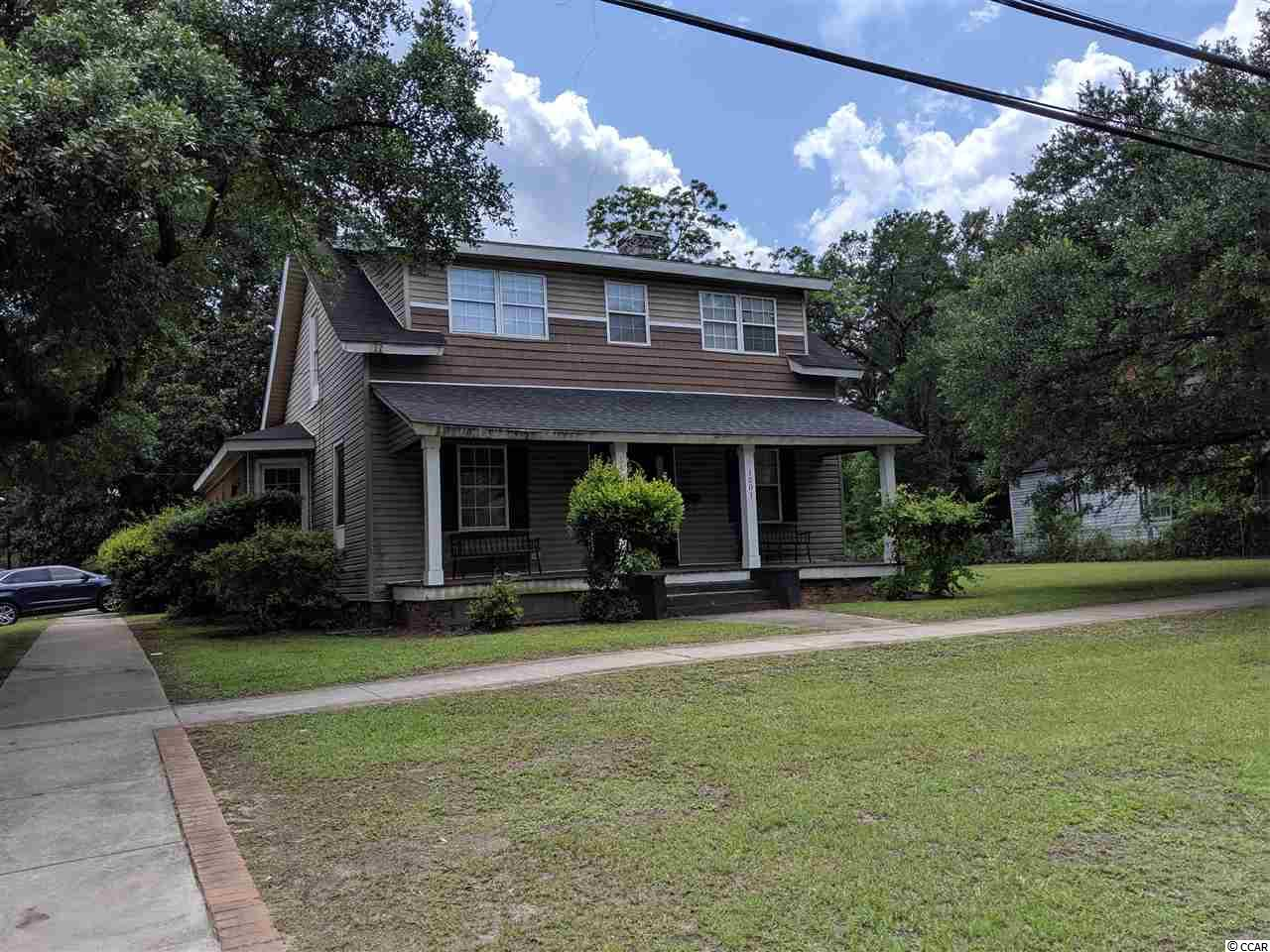 Five bedroom home in downtown Georgetown with lots of potential and charm. Only a couple blocks to shopping district. Large yard with storage shed. The streets are lined with beautiful live oaks and two pecan trees on the property. SO much potential, so little money.
