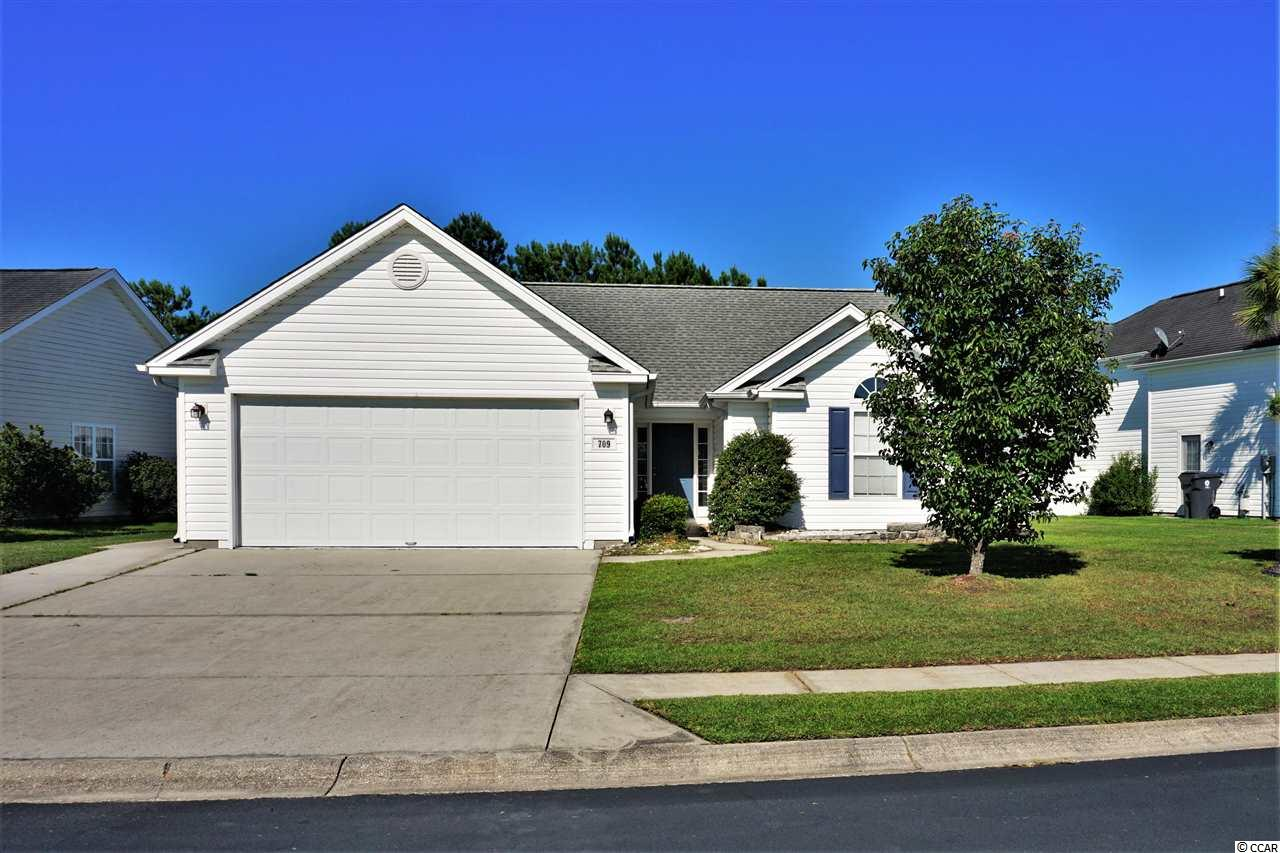 Located in the convenient Mallard Landing Village, this home has great curb appeal and is less then 5 minutes from the beach! As you enter through the front door, you are invited to the openness of a Living Room/Dining combo floor plan with vaulted ceilings. Enjoy a comfortable size Kitchen with breakfast bar/breakfast nook area. Be greeted by the early sunrise in the Carolina Room while looking out over the pond. This home features 3 Bedrooms and 2 Full Baths. The Master Bedroom is located in the rear of this split floor plan and the other 2 bedrooms are in the front of the home. Ceiling fans in all bedrooms, living room and Carolina Room. The Master Bath has a full size shower and 2nd bathroom is outfitted with a shower/tub combo. Add your personal touch inside that is in need of cosmetic updates, PRICED TO MOVE!! Attached 2 stall garage. As an added bonus, a cozy screened in back porch also with a ceiling fan!