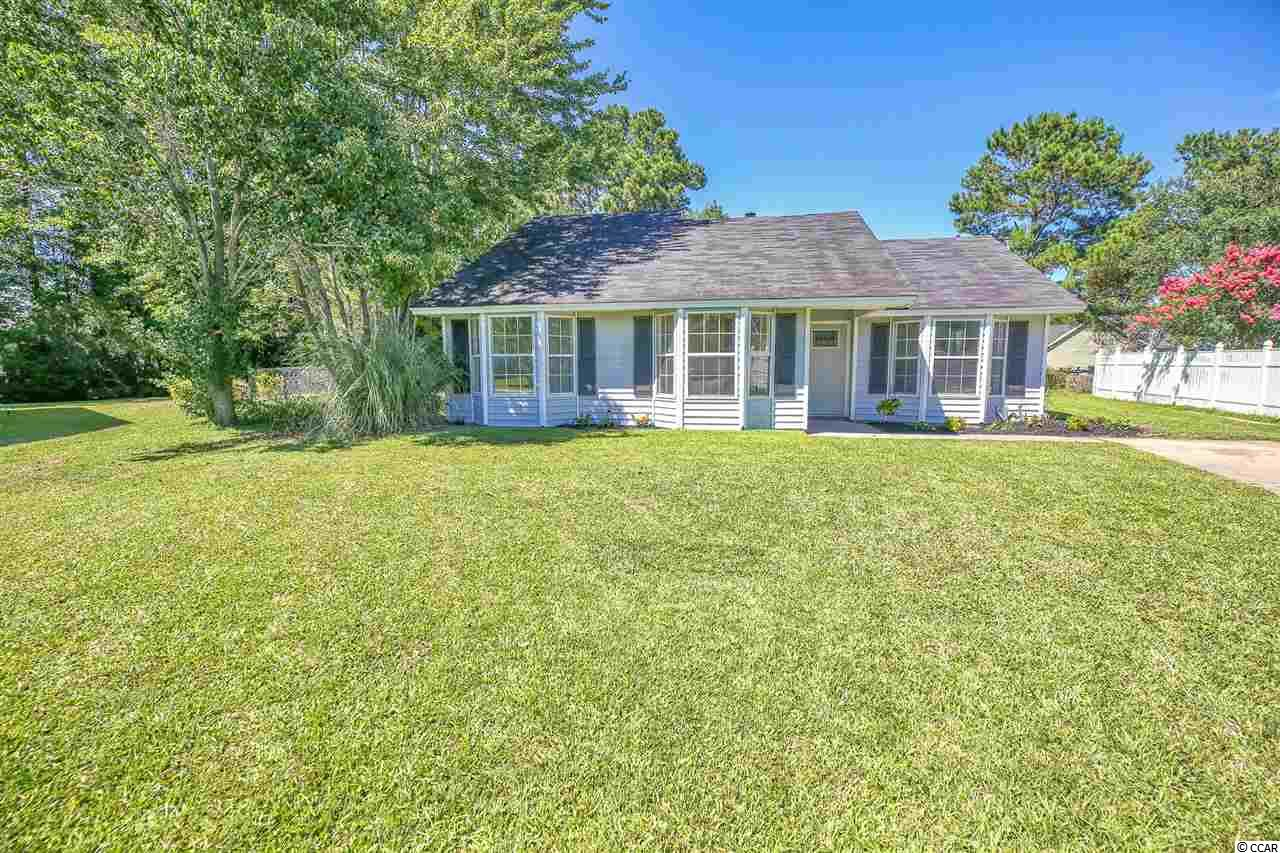 You won't want to miss out on this Great Priced Beach home in Murrells Inlet, SC, the Seafood capital of Myrtle Beach!  Beautiful picturesque backyard with deck/patio to enjoy those outdoor gatherings under the large oak tree.  The oversized lot has an additional large, shaded fenced area with  a special doggie shed that is 8.5 x 6!!   Inside you will find many upgrades in the 3 br/2 bath home featuring a wood burning fireplace, split floor plan, new HVAC system, new water heater, new exterior and interior doors, new ceiling fans, upgraded bathtubs, new toilets, granite counter in bath, stainless appliances, garbage disposal, eat in kitchen and new kitchen faucet.  Attached is a nice workshop/ storage area. Low HOA fee that includes a pool, playground and basketball court.  Walk out back and stroll over or hop on your golf cart and head to the Beach!