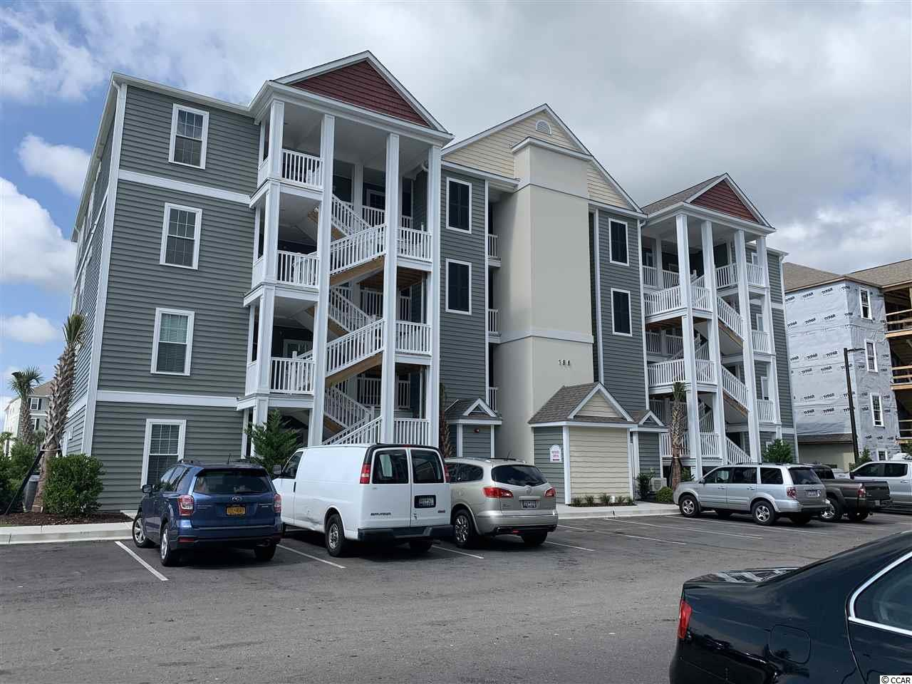 Located in one of the most successful condo developments in the Myrtle Beach area, this third floor unit is a 2 bedroom 2 bathroom beautiful condo in the very popular Queens Harbour! Building has an over sized ELEVATOR to all floors, outside storage, split bedroom floor plans with entry to the Master Suite from the Family Room, 9' smooth ceilings and a screen porch. The location is superb with shopping, dining and recreation steps away. The amenity package includes a resort style swimming pool with club house and conveniently located picnic areas with barbecues.