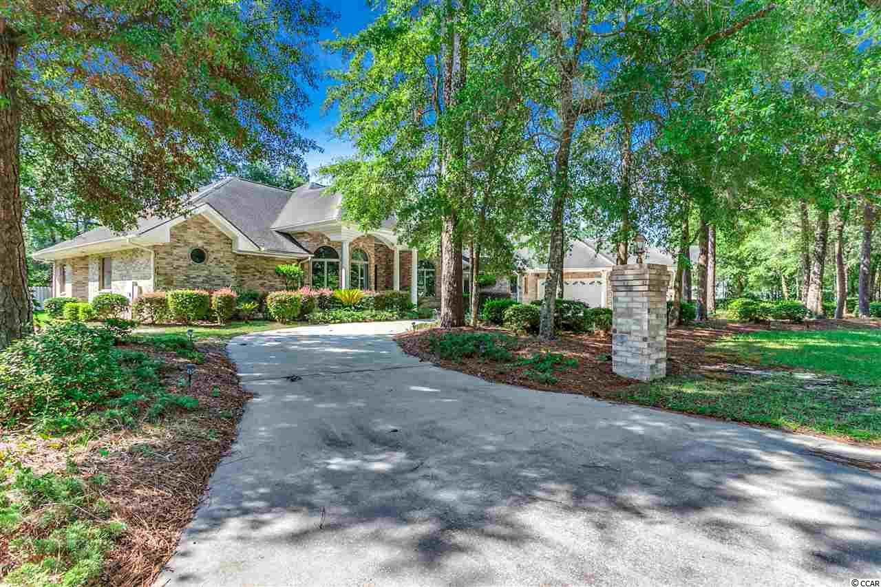 This beautiful ranch is conveniently located in Hagley Estates, 4.7 miles from Pawleys Island Beach with intracoastal waterways close by. The property has several different areas to relax or entertain in. Perfect for every occasion, oak floors, 3 car garage, crowned molding, and recessed lighting. If you like large screened in porches this is the home for you. Also featuring Large back yard, walk in closets, a gorgeously updated kitchen and a bathroom for each bedroom makes it ideal for families. Please call now with questions or to view the property.