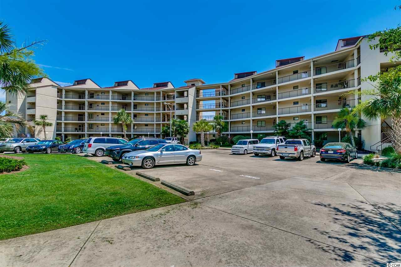 Come check out this updated, well maintained condo located in Coquina Harbour with spectacular water and marina views.   This spacious unit offers plenty of room to make this a primary or 2nd home.  Tile flooring in the living areas make cleaning a breeze.  There's custom cabinetry in the kitchen with an added pantry for ample storage.  There's even a large mud room with extra storage space.  The master suite features a custom spa shower with 7 heads and seating.  You'll certainly appreciate the very large wrap around porch with a custom seating area with fire pit.  This is really a one of a kind unit and you owe it to yourself to take a look.  O and by the way, the unit comes with a 38' BOAT SLIP that is located right behind the condo!