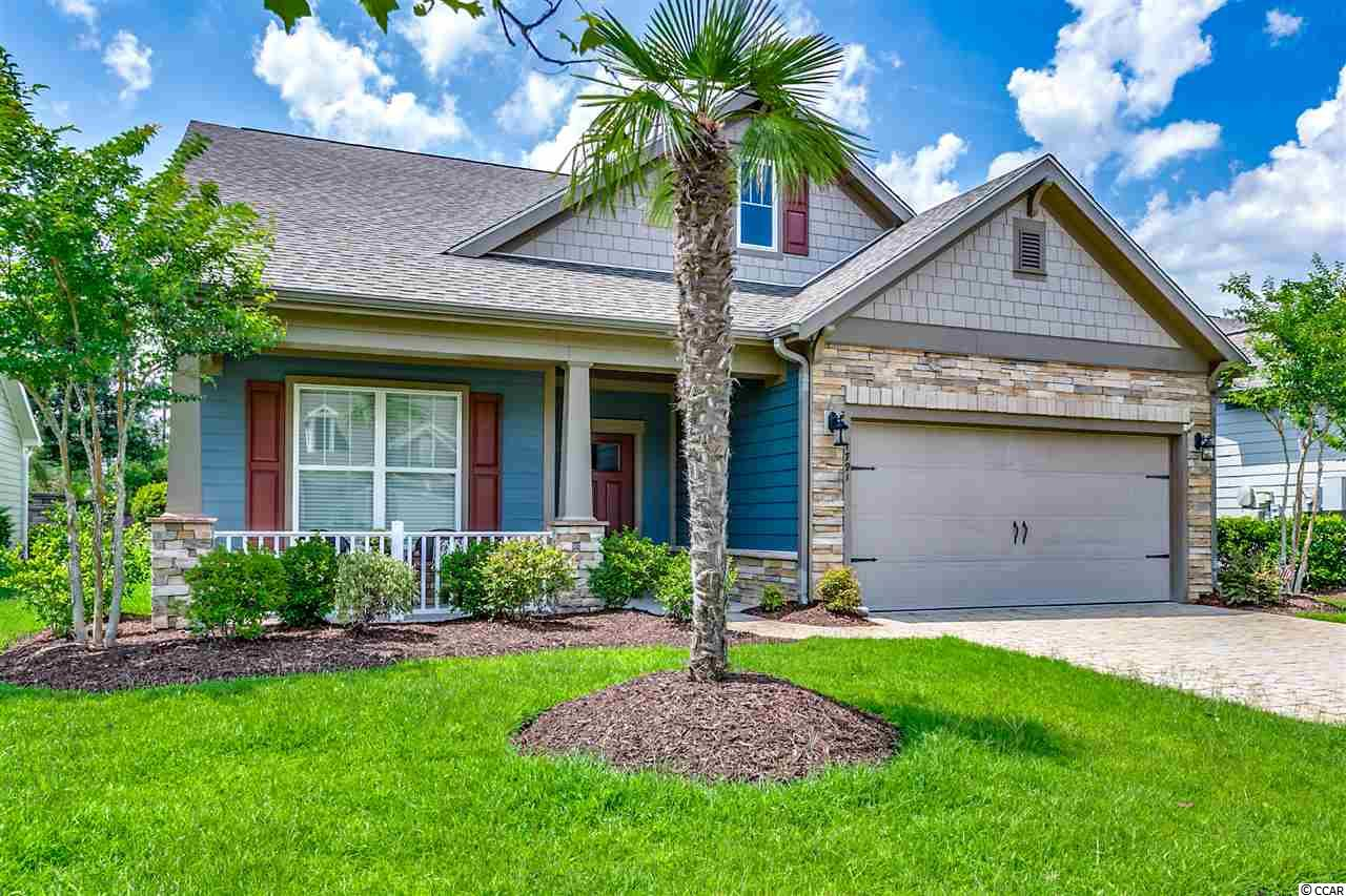 If you are looking to buy one of the most popular floor plans in the best-selling area in Myrtle Beach, your search is over! This like new, move-in ready, 3 bedroom plus office, home is located in Market Common, the best address on the Grand Strand. The shops, restaurants, movie theater, grocery store, recreation center, and parks are right down the street. Myrtle Beach State Park and the sandy shores of the Atlantic Ocean and are just a short golf cart ride away. Best of all you will be living in a neighborhood with a real sense of community and fellowship. This home has a hardy plank exterior and many other popular features including an open floor plan with vaulted a ceilings, granite counter tops, stainless steel appliances, natural gas stove, heat and hot water heater, custom moldings, and lots of natural light. The rear covered porch and patio provide plenty of outdoor areas to relax on, and overlook the beautifully landscaped and private, back yard. Call today for more information, and see this home before a great opportunity slips away.