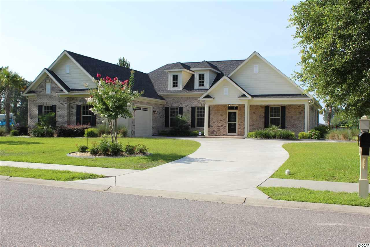 Don't miss this rare opportunity to own a fully furnished spectacular better than new one year old home that was custom-built for the owners as a vacation retreat. This single level custom built all brick 3 bedroom 2 bath home with large side entry side load garage is located in the prestigious luxury lake/golf course community of Wild Wing Plantation. This lake front lot offers serene views of the 180 acre lake Enjoy the many South Carolina lake birds, including blue heron, egrets, hawks and even eagles from the rear of the home and from the screened in covered back porch and the 4 season sun room.  This beautiful custom-built home is loaded with luxury upgrades throughout that distinguish this home form the tract builders. The foyer opens up to a private office/study and into a large great room that leads to a 4 season sun room which overlooks the 180 acre lake and the large fenced in backyard. The kitchen, family room, office, and all wet areas feature luxury porcelain ceramic wood plank tiles. The family room has a coffered ceiling and a gas fireplace that is surrounded by built-in cabinetry. The family room is open to the chef's kitchen that has stainless steel appliances, a large island, granite countertops, large oversized walk-in pantry, kitchen nook and custom kitchen cabinetry that features soft close dovetail drawers, and doors. The master bedroom suite has an oversized spacious walk-in closet, double tray ceiling, his/her sinks, vanity, a separate tiled tub shower which creates a special ensuite. The kitchen, family room, office, and all wet areas feature luxury porcelain ceramic wood plank tiles. The family room has a coffered ceiling and a gas fireplace that is surrounded by built-in cabinetry.   The home has been professionally landscaped with multiple palms, ornamental trees, bushes, oversized paved cement driveway with turnaround, screened in porch with custom tile and ceiling fan, multiple Curbscaped flower beds surround the home, irrigation system, gutters and much more.   Wild Wing Plantation has over 180 acres of lakes for you to explore and enjoy. The community features custom built brick and stucco style luxury homes. Association amenities included large clubhouse, multiple outdoor pools, hot tub, 80' waterslide, tennis/pickle ball courts, basketball court, playground area, huge day dock, private boat ramp and owners private boat/RV storage. Wild Wing Plantation offers convenient easy access to Coastal Carolina University, shopping, the beaches and all that Myrtle Beach and Conway has to offer.  Be sure to ask your Realtor to inform you about the information on the included golf membership.