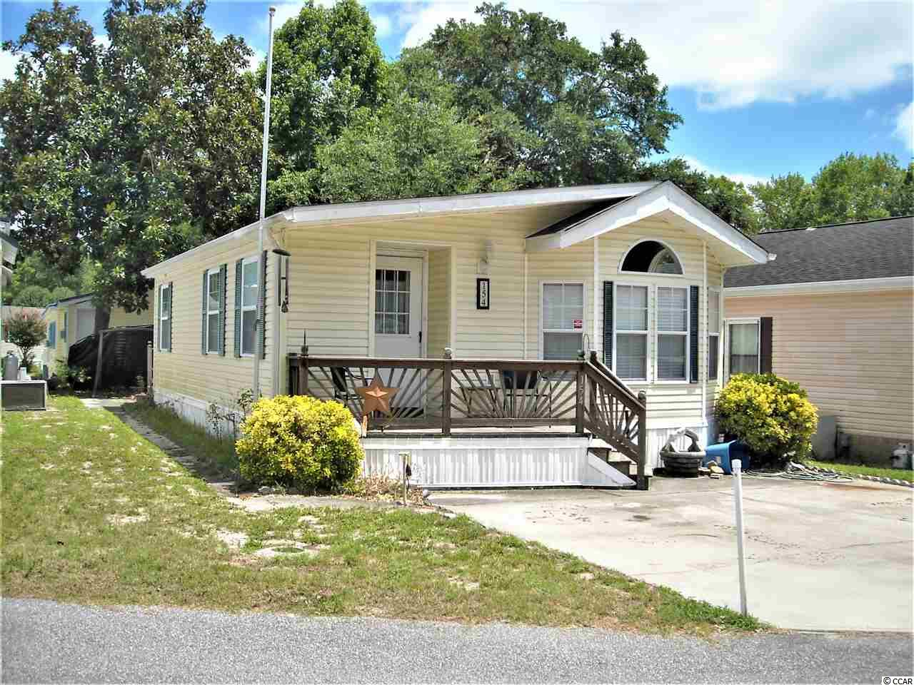 RV community located on the marsh overlooking north end of Cherry Grove beach. Community offers several lakes/ponds, 2 heated pools, Jacuzzi, picnic areas, basketball, horseshoes, tennis courts, club house, mini golf, beautiful sunrise views. This 2 bedroom 2 bath home is unique because it has 2 water heaters, which means no cold showers, and the laundry is inside, versus in the storage building, which many homes have. This casual lifestyle is made easier by driving your golf cart to local spots of interest. Enjoy this home as a retreat, or, as many neighbors do, a full time residence. Start relaxing!