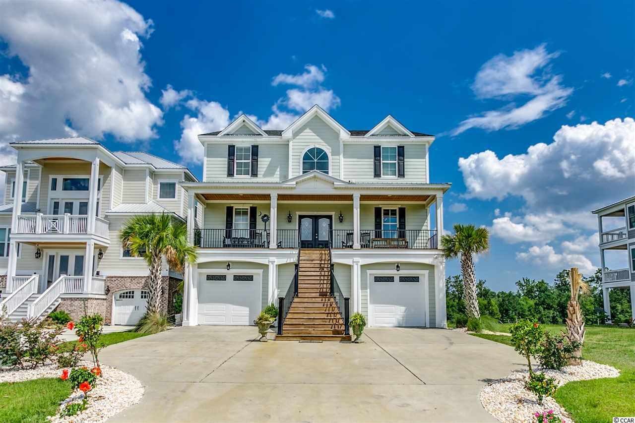 Beautiful custom home on the Intracoastal Waterway in the gated community of Boardwalk on the Waterway. Custom kitchen with granite counters and professional grade appliances.  All the wet areas are tiled and all the bathrooms have tiled showers.  The ground floor features a massive garage that leads to the outdoor entertainment area with a inground pool, spill over spa, and a private dock with a boat lift. The house has an elevator shaft with an option to have it installed.  The community also has private boat storage, 5 day docks, boat launch, security and a 2500ft boardwalk along the Intracoastal Waterway. Floating dock and 16,000lb boat lift already in place.