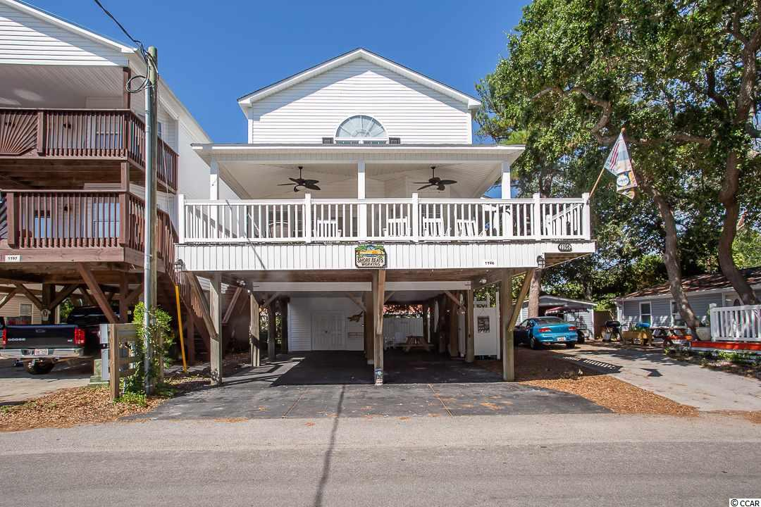 Welcome to beautiful Ocean Lakes. This beautiful 4 Bedroom, 4 Bath Raised Beach house is very nicely decorated to become your primary residence or a great investment property. It is situated right down the street from the ocean with views from the front balcony of the ocean. Huge front porch and downstairs sitting area with built in tv make this home great for entertaining. Home has been meticulously maintained to show great. Once inside the home you see the upgrades from granite counter tops to stainless steel appliances and high end furnishings. You have one bedroom on the first floor living quarters so you don't have to go up stairs to access the 3 other bedrooms. This has a full Bathroom. Up stairs you have the master suite with a walk in closet and vaulted ceilings which gives a very nice open feel. Make this you dream home today. Square footage is approximate and not guaranteed. All information is to be verified by buyer and buyers agent.