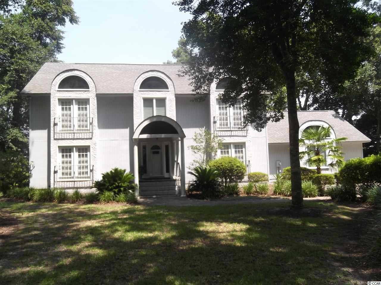 This is a very nice home in a very nice waterway community. Directly on the Intercoastal Waterway with great views. Watch the boats go by as you sit on a very large deck; also waterway views from the back of the house. Bulkhead put in a few years ago with a boat slip. This home is not in a flood zone; no flood insurance required. The lot sits up very high from the waterway. The home has a formal dining room, eat in kitchen, very large living room with a fireplace also a large den, a large wet bar with one bathroom downstairs. Very nice entry foyer. Upstairs are 3 bedrooms  and 3 bathrooms. The master bedroom is very large with a large sitting area looking at the water way with a balcony also has a fireplace in the master bedroom with a wet bar, a large master bath with a jetted tub. There is another large bedroom that looks over the water way with a balcony. Then another good size  bedroom, laundry room upstairs with the bedrooms. Over size 2 car garage. The community is located near everything and anything anyone would need or want to do. Many restaurants near by also shopping, many golf courses and only a few minutes to the beach. This is a well built home with a few upgrades would make a great home. Very private setting which you will enjoy. So do yourself a favor and view this home.  I do not think you will be disappointed.