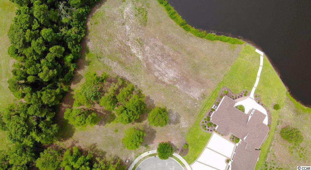 Looking to build your dream home on a golf course near Myrtle Beach? This is the perfect opportunity. The demand and prices for lots like this are continuing to increase. This is a .61 acre lot on the water in the prestigious Wild Wing Plantation. With great amenities and golf course. The amenities include a pool with kids slide in separate pool, exercise room, tennis courts, and basketball court. This lot is priced to sell. Check this out before it is gone!