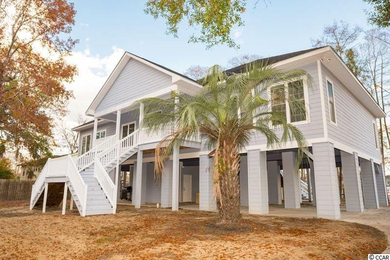 Double lot opportunity!  Your dream of living on the Intracoastal Waterway on a double lot can now become a reality! You don't want to miss the chance to see this 4 bedroom, 4.5 bath, waterfront raised beach home. Use your elevator to access a welcoming floor plan that begins in a bright and airy kitchen with granite countertops and an over-sized breakfast bar perfect for gatherings.   The kitchen opens into a spacious great rom with stunning views of the Intracoastal. The luxurious master suite includes a sitting area, walk-in tile shower tub and large walk-in closet.  Both the master suite and front bedroom offer direct waterfront views with an abundance of natural light and windows at every turn.  Other features include pristine wood flooring through, a large front & rear porch, laundry/utility room, plenty of parking and storage unit below.  This property does include the dock. This charming neighborhood is a boater's paradise, has no HOA, and is just miles from the beach, Market Common, fabulous attractions, shopping and dining.