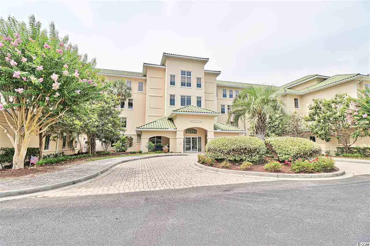 This beautiful top floor unit in the gated community of Edgewater at Barefoot Resort is one of kind! The owners have remodeled the entire unit within the last year, the unit features a spacious living area, cathedral ceilings (only found on the 4th floor), beautiful master bedroom, guest room and balcony. There is hardwood flooring throughout the living, kitchen, dining and laundry areas. The kitchen features granite countertops, dark stainless appliances, farmhouse-style sink, and a new washer/dryer. The master bath features a huge walk in shower and jacuzzi tube with pebbled mosaic floor tile and new vanities. Both Bedrooms and balcony have a spectacular view of the pool and Inter Coastal Waterway. The owners have a private storage area and a shared garage. Edgewater owners can enjoy the beautiful pool and hot tub. The community also features a clubhouse & fitness center. Owners have access to a private beach cabana with seasonal shuttle service as well as all of Barefoot Resort's wonderful amenities such as the 4 championship golf courses, driving range, pool at the Marina and more! Please do not miss this opportunity to own a truly unique home on the Waterway!
