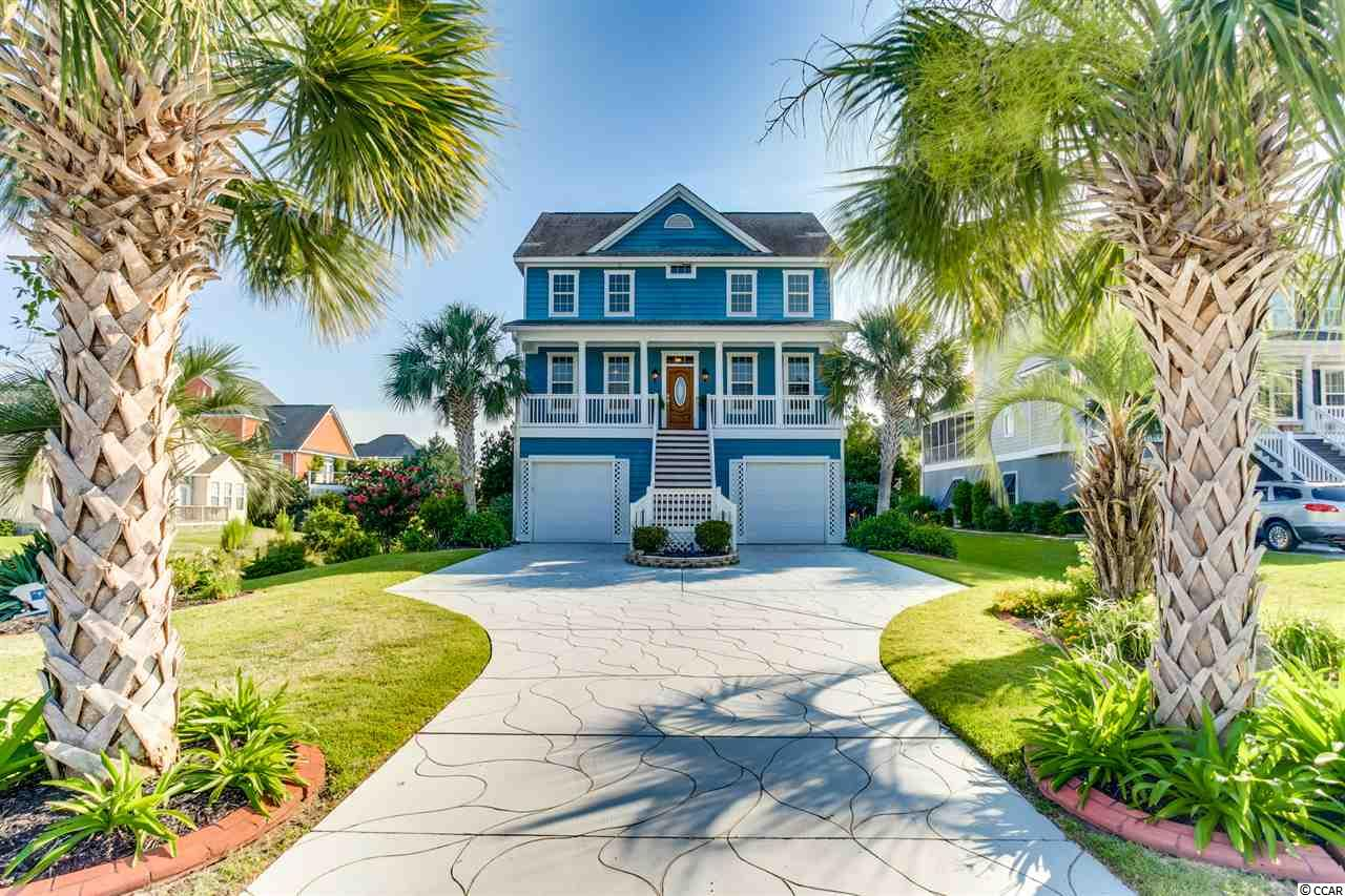This is your chance to own a beautiful piece of paradise. This executive home is about 1 1/2 Blocks from the beach! It is located in a quiet neighborhood called Savannah Park.  This 4 Bed 2 1/2 bath raised beach home is perfectly designed to live in and entertain guests. The open floor plan is very welcoming from the time you come through the front door. You will first be pleasantly surprised to find the entire first floor living space tiled, this really is a must when living along the beach.  The main floor living space can be appointed in many different ways and includes a formal dining room.  The master en suite is also on the first floor for your convenience.  There is a flex room/Den/Study on the first floor, that you can use however best meet your needs. Upstairs there are 3 large bedrooms and one bath.  Off of the larger Bonus/bedroom,  there is a walk-in attic. The walk-in attic comes fully floored, for extra storage.  The entire home has just been painted with a Sherwin Williams Cashmere Modern Grey, in a matte finish.  The upstairs has also been updated with a luxurious 52 oz carpet, in a light neutral color.  This home is a blank palate for you to add your special touch and personal home decor. Now that we have discussed the unbelievable interior features and upgrades, let's discuss the outdoor living. Just off your dining room is a large screened porch, that will allow you  to enjoy those wonderful coastal breezes. There is almost 1600 sqft of under the home parking and storage. The yard features mature tropical landscaping with lots of color.  The most sensational feature of this home is the private heated salt water pool and hot tub. Imagine sitting in your warm spa relaxing and then just step over into your cool refreshing pool.  Life doesn't get any better than this. This home sits on a large lot and that has plenty of green space for the kids, pets, and gardening. This property has NO HOA FEE! There is Rhino Shield on the exterior that has a transfe
