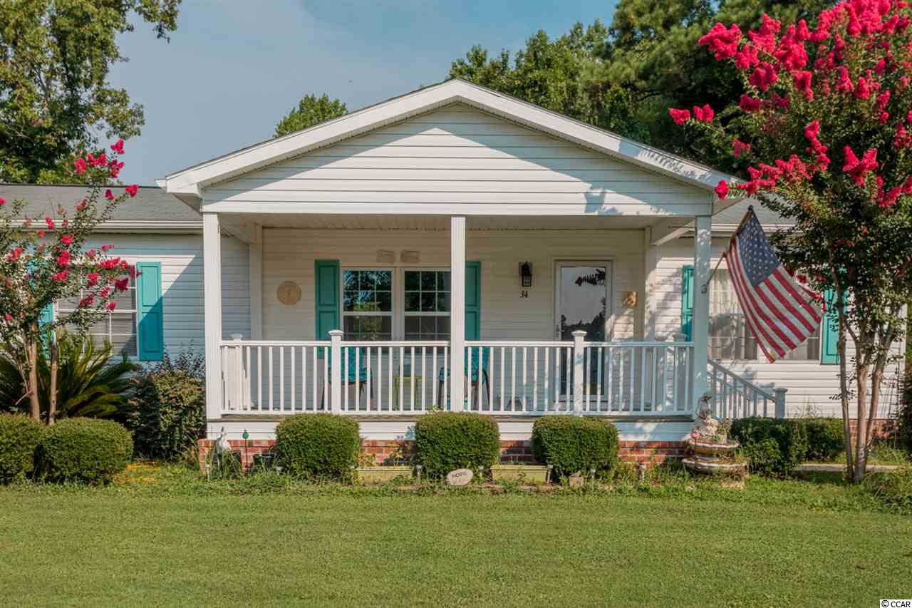 Open House 16 Aug 2019 from 10am-1pm. This lovely home in the sought after neighborhood of Hawks Nest is a must see! Home has been upgraded with luxury vinyl tile floors, shiplap focal walls, spacious covered front porch overlooking the lake, and a back yard deck. Home is located on a cul de sac with no through traffic. All appliances convey including washer/dryer. New AC unit and electric fireplace a plus! Come see this one for yourself! Close drive to Marsh Walk, Waccamaw hospital, restaurants, and shopping. Measurements are approximate and must be verified by buyer.