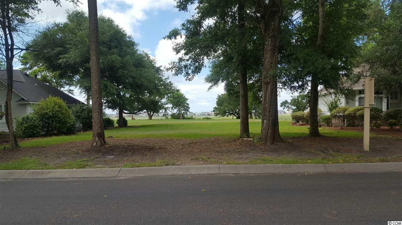 Stunning lot in Tidewater Plantation with both a marsh view and views of the 3rd and 4th holes of the golf course.  There is no time frame to build on this beautiful level and clean lot.  Move to Tidewater and enjoy the numerous amenities that it offers.  The plantation has 4 pools, jacuzzis, hard and clay tennis courts, bocci lanes, basketball courts, a giant beach cabana and of course an award winning golf course and country club.  Buy this lot and there are a number of quality builders in Tidewater who can build your dream home.  Come and see this beauty!