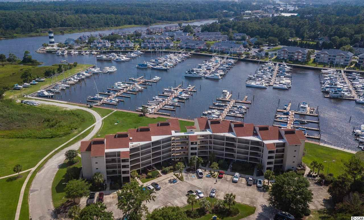 If you have been looking for a luxury waterway condo fully upgraded, move in ready with a 36 foot boat dock included, here you go! This condo has been completely remodeled from top to bottom and owner has left no stone unturned. This unit is gorgeous and you won't find anything like it. Completely renovated in 2018, everything is new. EVERYTHING! You don't have to come in and do one thing. Unit is on the 4th floor but there is an elevator so no stairs needed. Building and unit sit conveniently in the heart of Little River overlooking the Intracoastal Waterway and Marina. Did I mention you also get a 36 foot private boat dock at the Marina? Unit features luxury upgraded tile throughout, beautiful kitchen with brand new granite counters, upgraded stainless steel appliances and new cabinetry. As you walk out into the spacious living room, you will see a glass door leading out to the very large covered balcony overlooking the Waterway and your boat docked at the Marina. Both bedrooms have been upgraded and are very spacious and both bathrooms have been completely remodeled as well. When you're not on the boat or on the balcony looking at the stunning views, take a dip in the large community pool. HOA fee is very reasonable and includes almost everything! There aren't enough words to describe how amazing this unit is, you just need to come see it for yourself. It's easy to see so come take a look today!!!