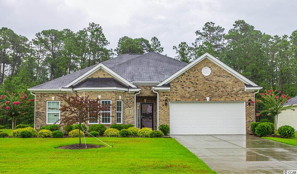 """**OPEN HOUSE Saturday, July 13th from 12:30 PM until 3 PM. Make plans to join us!** Beautifully well-maintained home in an established community, Ridge Pointe presents this newer home built in 2015 and was used only as a second home for the first two years.  It's better than brand new as all the work has been done for you. Come and take a look, it is Move-in-Ready! This home has it all with loads of recent upgrades with the open concept Magnolia floor plan. Features include Oak Hardwood Floors, 42"""" Maple Cabinets, Granite Kitchen Counters, 18"""" Tile Floors, large nine foot Ceilings and Fans just to name a few of the home's upgrades. The lovely and inviting Foyer presents this ranch beauty and leads you to the spacious eat-in Kitchen with a Breakfast Nook & Breakfast Bar, Granite Counters with a large Cairn Kitchen Farm Sink and a built in Desk. But Wait! There's More!! The large Great Room, with a Gas Fireplace, overlooks the 14x18 Carolina Room. More recent improvements include the Sun Room added on with a fan and electric heat. There is a Gas Grill hookup in the back yard for all those family and friends' get-togethers! The automatic Irrigation System nurtures one of the largest manicured lawns in the neighborhood and backs up to the forever wild area. If you are looking for privacy, this is it! The spacious Master Bedroom Suite is the owners' favorite rooms as it comes with a Sitting room, large walk-in His and Her Closets, the Master Bathroom has a Vanity, dual sinks with a Dressing Table, a Soaking Tub and a Walk-in Shower. Large windows offer natural lighting as well as two Solar Tubes all of which enhances the Living Room lighting. There are beautiful arched doorways within the home. There is a Laundry Room that will hold a full size Washer and Dryer. There is easy access to the 2-car Garage which also has a Utility Sink. There is so much to see. Make an appointment today to see this house and make it your home!"""
