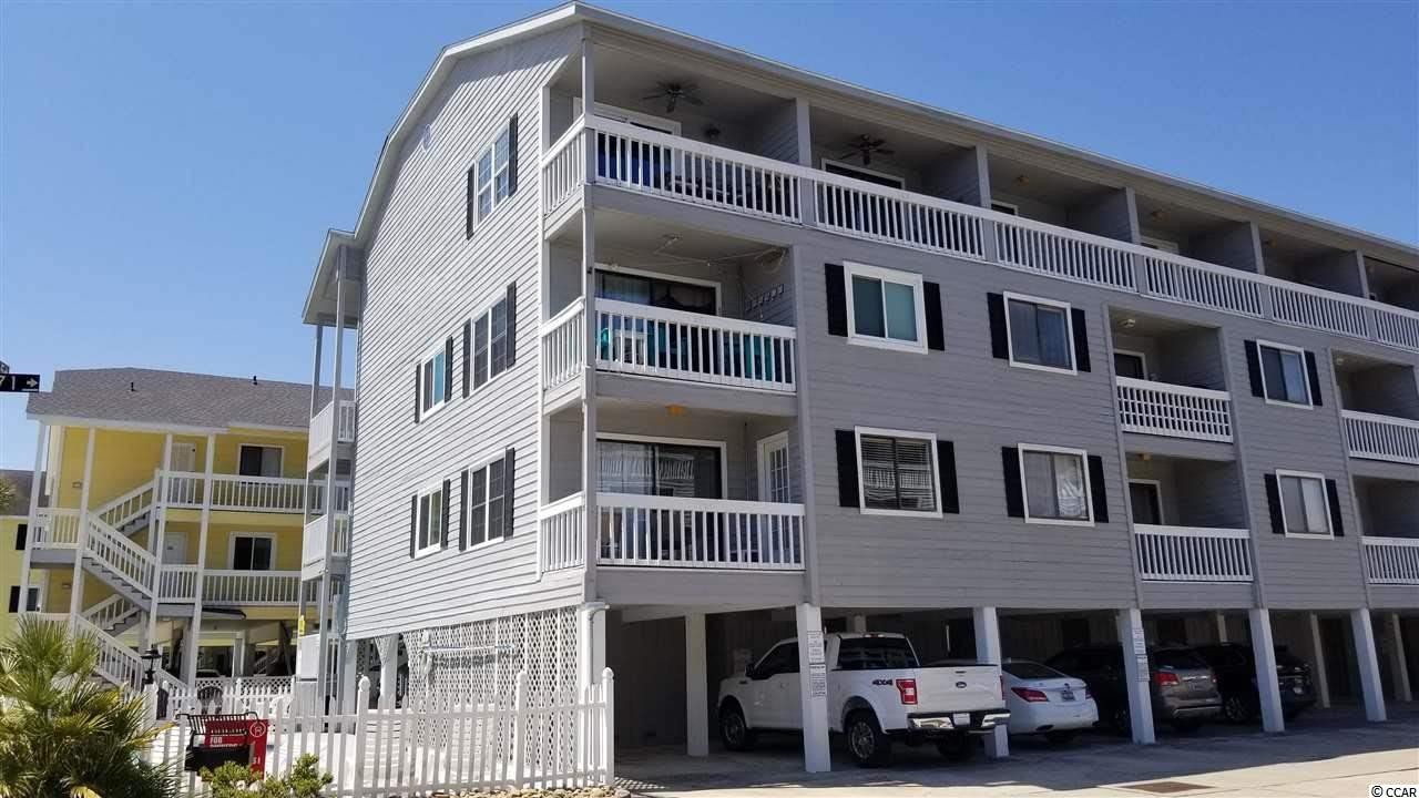 Great location across from the beach with partial ocean view from your balcony! Immaculate 2 bedroom condo. Wood laminate flooring, bright unit with skylight that allows for a lot of natural light.  Off living area is sliding glass doors that take you onto your balcony with views of the beach.  Sold furnished all you need are your bathing suits!   Amenities include private pool, BBQ grill and picnic table, storage unit.