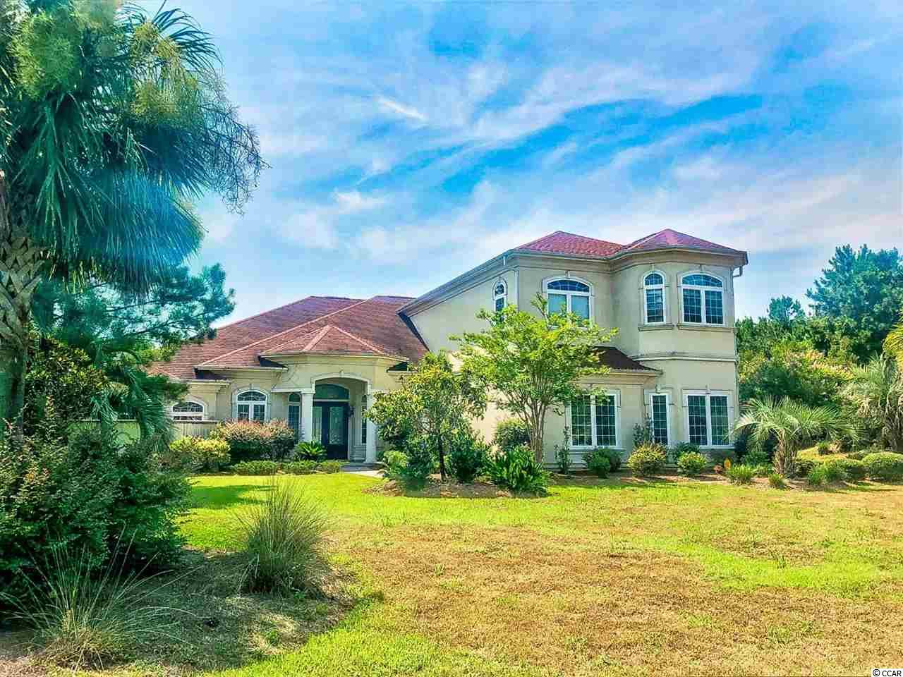 This gorgeous 4 bedroom, 4.5 bath custom home is located in the prestigious community of Plantation Lakes. The home boasts 12' tray ceilings as well as beautiful tile and hardwood floors that run throughout the entire main floor. The kitchen is equipped with all stainless steel appliances, a gas stovetop, a wine fridge, high-end cabinetry with a unique backsplash, granite counters, and a bright breakfast nook. The master is located not eh 1st floor and features a huge walk in closet and master bath with double sink vanities, whirlpool tub, and luxurious tiled walk in shower, while the remaining 3 bedrooms are upstairs. A loft upstairs would make the perfect play room, bonus room; the options are endless. Other features of the home are a formal dining room, an entry closet, oversized crown molding, a screened in porch with built in BBQ, and a fenced-in pool area with a hot tub and a view of the lake. A two car garage along with plenty of storage closets throughout adds ease and convenience. Plantation Lakes amenities include three pools, boat dock, tennis and basketball courts, owner's clubhouse, playground, and sidewalks to enjoy an afternoon stroll. Close to many great restaurants, stores, shopping, and approximately 10 minutes to the best beaches along the Golden Mile of Myrtle Beach. Don't miss this opportunity...schedule your showing today!