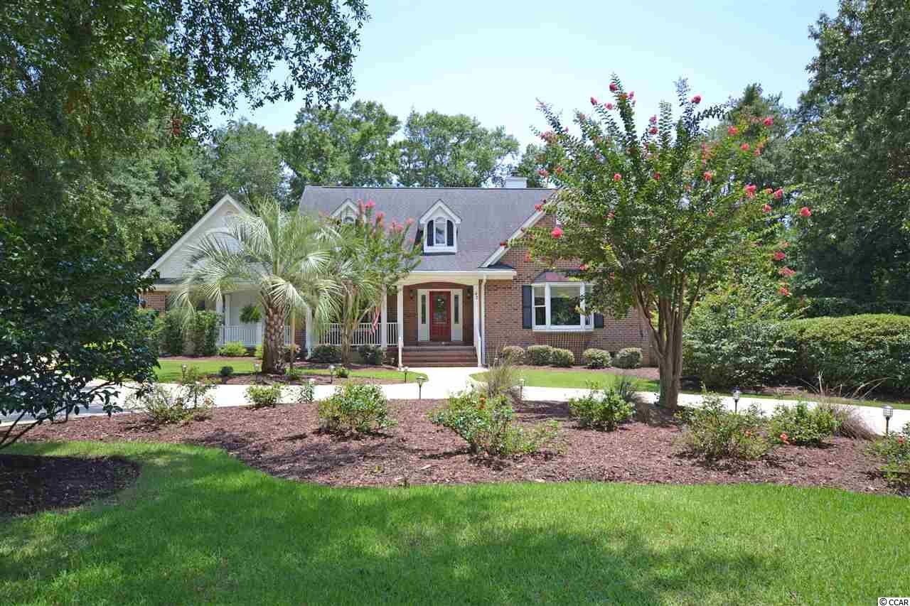 This spacious brick home is located on a quiet cul-de-sac in desirable & gated Willbrook Plantation.  This beautifully landscaped home has 4 bedrooms and 3.5 bathrooms with a separate study/office and large bonus room.  Situated on the 15th fairway of the Willbrook Plantation golf course, the outdoor porches are a wonderful place to enjoy morning coffee or an afternoon drink and watch the golfers go by!  The living spaces in this home are endless...a den that includes a gas fireplace, a huge Carolina/sunroom with a wet bar that connects to a sun/screened porch are all on the first level. The large first floor master suite has a large walk in closet and gracious master bathroom.  The second floor has two bedrooms, a bathroom and contains a cozy den that includes a small kitchenette and separately controlled HVAC.  There is a second back stairway from the garage for privacy to the upstairs living quarters.  The kitchen boasts of granite countertops, stainless steel appliances, custom cabinets and a walk in pantry.  42 Warnock Way also features a dining room, breakfast room, home office, a 3 car garage and lots of storage space!  Willbrook Plantation offers a clubhouse and pool and access to Litchfield by the Sea amenities including the private beach!  Pawleys Island is located just a 70 mile drive for a day trip to historic Charleston, SC or 25 miles to the attractions of Myrtle Beach.