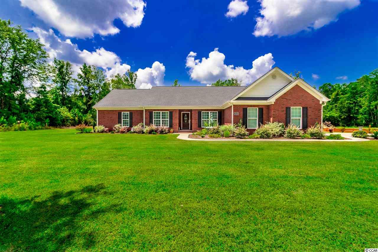 If you are looking for an all brick home that boasts country living but, is still conveniently located near all attractions, then look no further! This 4 bedroom 2 full bath ranch style home was built in 2015 on 6 acres of land and boasts NO HOA fees. From the welcoming front porch and well manicured landscape to the cozy living room with gas log fireplace, this property instantly makes you feel right at home. With gorgeous 5 inch Arcadia golden engineered hardwood throughout, it's impossible not to appreciate the care that this home has received. Granite countertops, ample cabinet space, large pantry, SS appliances, breakfast bar & nook make your kitchen goal checklist complete. Master suite has a large walk in closet, extra vanity space and garden tub with whirlpool jets. Down the hall you will discover 3 additional guest rooms with second full bath to provide plenty of space and privacy for guests. Glass double door entry to your front room could be used as a formal dining room, office, play room...the possibilities are endless. Walk outside to take in the spacious outdoor living space, including an above ground pool, outdoor storage shed and 6 acres of beautiful land in which a large portion was recently already cleared. Close to schools, dining, shopping and just a short drive into Myrtle Beach and the historical downtown Conway. Square footage is approximate and not guaranteed. Buyer is responsible for verification.