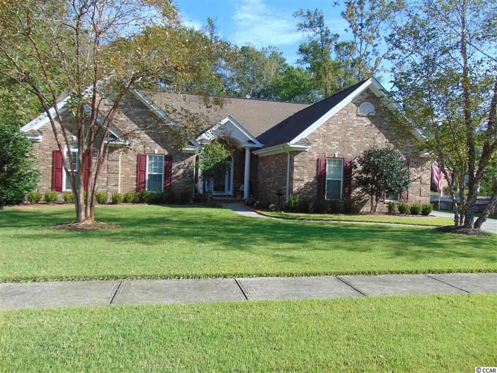 """DON'T WAIT TO SEE THIS GORGEOUS HOME! This custom home in the highly sought out neighborhood of Cypress River Plantation is the perfect size, not too big and not too small, with great curb appeal and a gorgeous private back yard! Recently added curbscape and new landscaping make this property stand out. This custom home has a split floor plan with 3 bedrooms on the main floor, a huge kitchen/dining area-great for entertaining and a spacious living area with cozy gas fireplace and new flooring. The master suite occupies the entire right side of the home with plantation shutters opening to the private back yard. The garage entryway offers access to the main house, laundry room and the stairs leading up to over 800 square feet of living space! This private second floor has a full bath, 2 closets, a room that could be used as a mother-in-law suite, a media room or an additional bedroom suite AND an additional room that could be an office! There are built in speakers for surround sound upstairs and also down in the living room. The kitchen/dining area is over 400 square feet and has maple cabinets, quartz countertops and 16"""" tile custom laid diagonally. The best is yet to come! Welcome to entertaining at its best when you enter the back yard. There is a custom covered porch with steps that lead to a gunite salt water pool and waterfall installed in July of 2016! Pavers customize this space with a built in gas fireplace and built in gas grill to the left and a built in hot tub to the right. There is also a hot and cold outdoor shower for rinsing off after a day at the beach! The fenced in back yard backs up to the woods and privacy. If the house wasn't enough to wow you, the neighborhood will! The community has a resort style pool and clubhouse, lots of activities and private day docks with boat and RV storage. It is one of the few communities with DIRECT access to the Intracoastal Waterway! The tasteful entrance leads you through meandering streets and mature trees and g"""