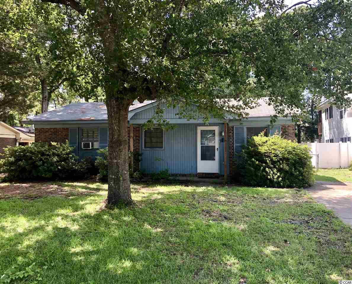 Three bedroom one bath all brick home. Large fenced in backyard.  East of Business 17 in Surfside Beach.  Home is in need of some TLC but has lots of potential.  Great opportunity to own with a short golf cart ride to the beach.