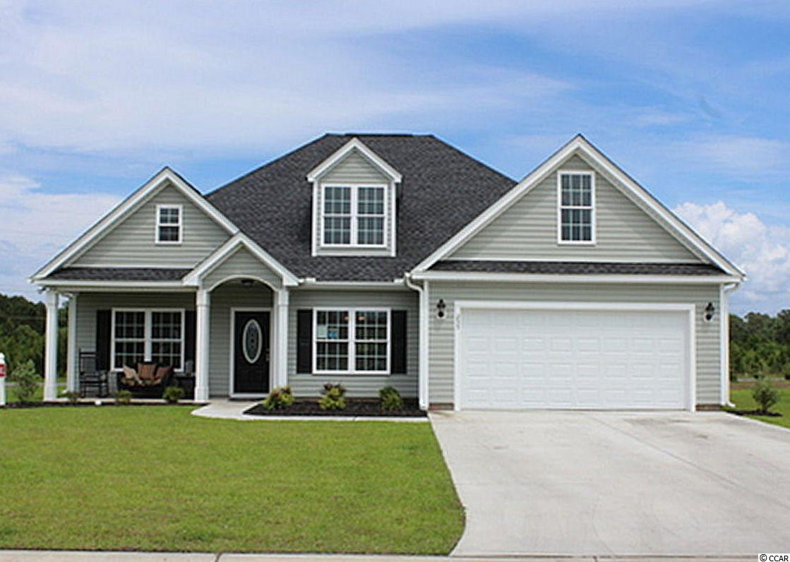 Oak Grove is a new small community just off Hwy 378 in Conway. Large 1/2 acre lots. No HOA fee. This great Hemlock plan has a low country covered front porch and 12'4x11'2 rear screened porch, a 22'x10' patio, very large living room has vaulted ceiling with fan/light, and lots of windows. Formal dining room with tray ceiling. Kitchen has custom built wood cabinets with knobs and crown molding, stainless steel appliances including a gas range, breakfast counter/bar, and pantry. Master bedroom suite has tray ceiling, ceiling fan, huge walk-in closet, double sinks, raised height vanity, garden tub and a separate walk-in shower. Rannai tankless water heater. Natural gas. Our homes are built with a minimum 9' smooth ceilings, 30 year architectural roof shingles, sodded yard includes irrigation system, fully finished and painted garages with automatic door opener and pull down stairs to attic storage plus gutters. Can park your RV or Boat at your house. Just 30 minutes away from Myrtle Beach and all the fun, food and entertainment you expect. Photos are for illustrative purposes only and may be of similar house built elsewhere. Square footage is approximate and not guaranteed. Buyer is responsible for verification.