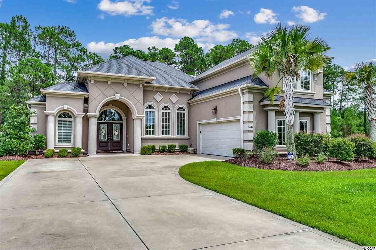 "Enjoy this luxuriously designed home that is nestled directly on the Wild Wing Plantation Golf Course's No. 3 and No. 4 holes. This gorgeous home is the Conway ""CP Quatterbaum Design Award of 2012 for Outstanding Construction of a Home. Enter into your front doors made of fiberglass dark walnut. Inside, there's 4 bedrooms, 2 bathrooms, engineered hardwood flooring, 12- and 14-foot ceilings and high-impact resistant windows, which provide an abundance of natural light. The first floor master suite is a retreat with 12-foot Presidential ceiling (also in living room, dining room) a large walk-in closet, double trey ceiling, ceiling fan and a perfect view out your window of the golf course. The master bathroom is equally impressive with a large tub, dual sinks, granite vanities, a tiled shower with a frameless glass door and a water closet. The Chef's Kitchen has granite countertops, tile backsplash that gives the impression you are in an Italian Villa, upgraded 42-inch upper cabinets, under cabinet lighting, stainless steel appliances, a Delta Touch Technology faucet, upgraded pendent lights and a nook. The open floor plan features a living room boasting a double trey ceiling and an enlarged Carolina Room with extra windows installed to provide more natural light.  This home is loaded with custom features such as Mediterranean style light fixtures in the foyer and dining room, double trey ceilings, upgraded fans and crown molding throughout. The attached 2-car garage has a premium epoxy flooring, cabinets, work bench and a slide and lock storage system. Outside, the stucco exterior blends so beautifully with the impeccably landscaped grounds, which includes flower bed lighting. There's a 16x24 patio with concrete pavers that provides the perfect place for outdoor entertaining, the serenity of a romantic dinner or to just relax and soak in nature. This custom built house was strategically built at the end of Wood Stork Drive so you have no community traffic and the benefit of the lot across the street from you being a non-buildable lot. The community provides a clubhouse for the two Larry Nelson and Jeff Bauer designed golf courses, a pool complex, sports courts, a playground, fitness center, boat slips and more."
