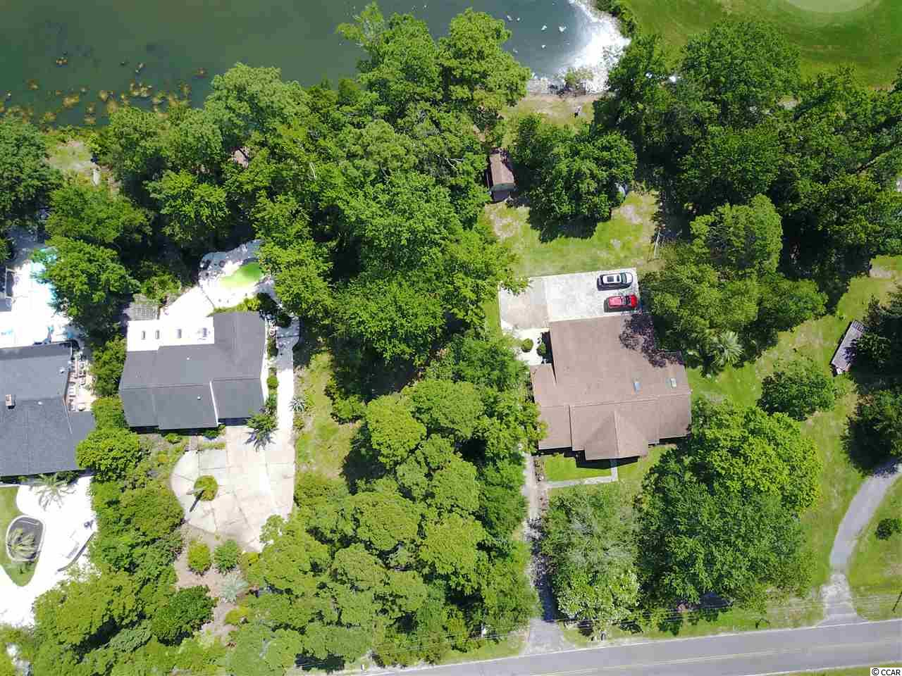 Fantastic location to build your home! This beautiful, nearly half acre lot is on a quiet street in the Hagley Estates community and backs up to a gorgeous view of water and the Founders Club golf course. And, no HOA fees! The boat landing to the ICW/Waccamaw River is just a hop, skip, and a jump to the West, and the beautiful Pawleys Island beaches are just minutes away to the East! Hagley is close to all that Pawleys Island has to offer: locally owned restaurants, specialty boutiques, and lots of golf courses! Come build your dream home and enjoy coastal living!