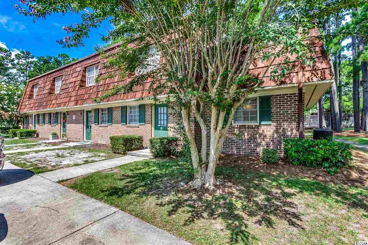 "Walking distance to CCU (Coastal Carolina University), and minutes to Shopping, Dining, MORE!! This brick, END unit is two-story and is equipped with 3 bedrooms, 2 full baths, newer wood laminate flooring, Updated Kitchen with Granite Countertops, darker-colored carpet (in great condition), and neutral walls throughout!  Step through the glass sliding back door and Enjoy the privacy, yet open air on the private, fenced in rear patio!! This unit is in great condition & ready for you! Great investment, great unit, Great price; rather you're looking for rental income, a 2nd home, or a place to call home permanently…don't buy without seeing this one.  HOA includes TWO Pools, Trash, Common & Building Insurance, Common Electric & Lights, Water & Sewer for each unit (HOA does NOT include interior ""HO6 Policy"")."