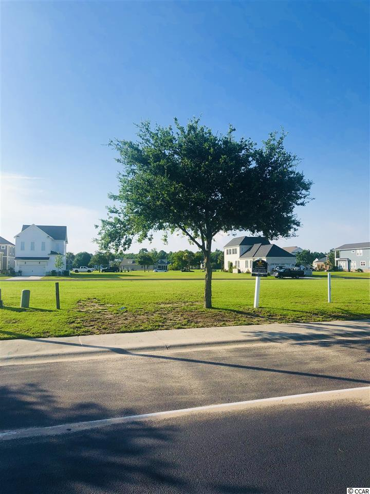 Second row from the waterway building lot in a gated, waterway community. No time frame to build and bring your own builder.  Amenities Include: Beautiful Club House, tennis courts, basketball courts, olympic size pool, planed activities for home owners, boat storage and boat ramp.  This lot won't last long at this price!