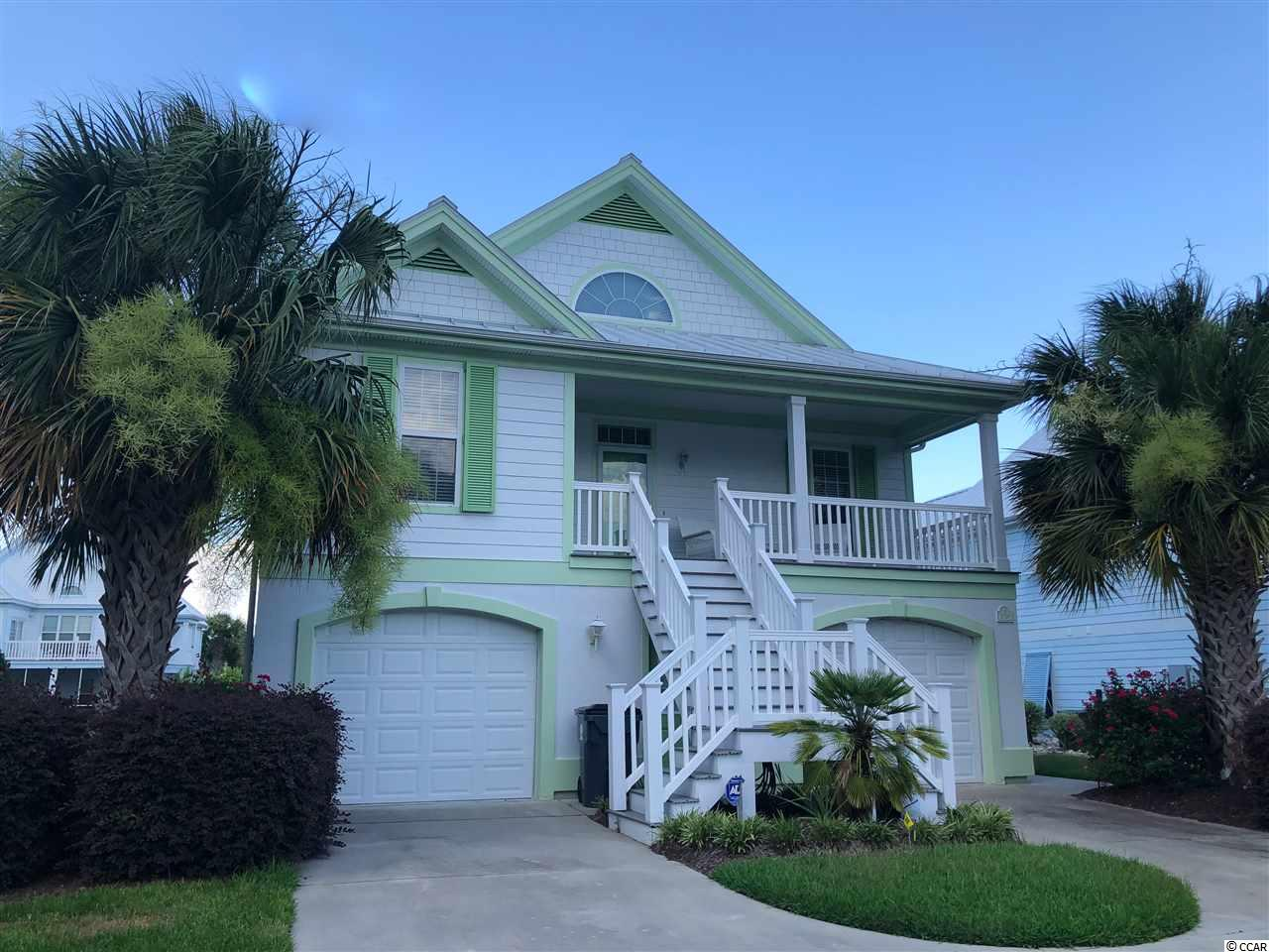 What a gorgeous and HUGE home near the ocean. Oceanside Village has its own gated beachfront access, with a bathroom and gazebo, next to the Conch Café. Imagine going to the beach by golf cart, lunching on the porch of the Conch with a divine ocean view, returning to taking a dip in one of the two community pools, and having a raised beach home large enough for the whole family! Bermuda Bay is a beautiful neighborhood inside Oceanside Village. The pastel homes are stately, and this home boasts five bedrooms, four and a half baths. The downstairs could be a separate apartment for mother or guests, or rentals, since it has its own kitchen, living/dining, two bedrooms and large bath. Upstairs, you find a huge master suite, another master suite, and a kids' room with bunkbeds, a twin and a sofa. The kitchen is open and airy and connects to the dining area. The neighborhood has a giant community center, with fun activities, tennis, bocce ball, pickle ball, playground, dog park, and much more. Lakes and green areas are found all around the community. You will love the fitness center and library. Don't miss the chance to buy into this lifestyle! This home is beautifully and elegantly furnished. Ready for you to enjoy...