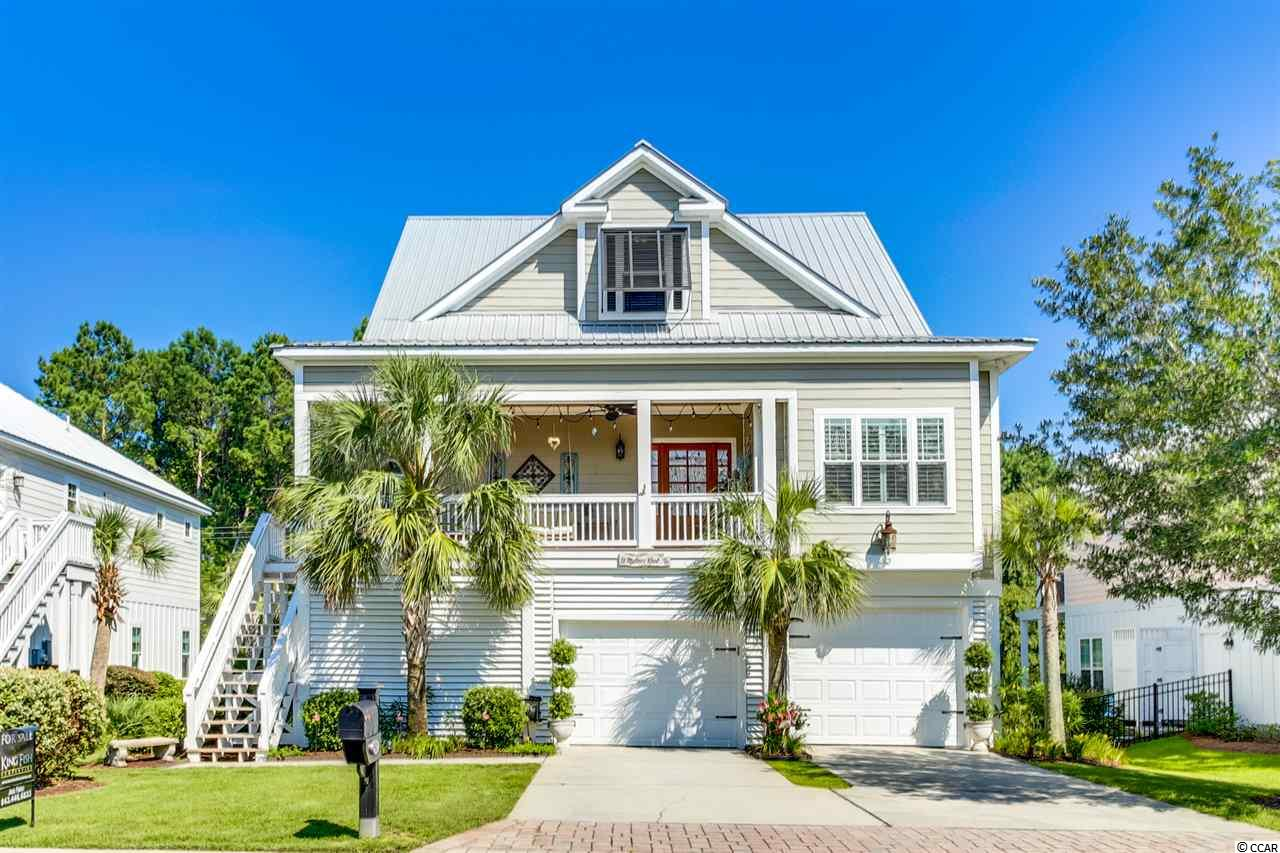 AMAZING 4 BED/3.5 BATH in the heart of Murrells Inlet EAST of Hwy. 17 Bypass only 5 minutes from Huntington State Park Beach and Litchfield Beach. Just a short golf cart ride to the Murrells Inlet Marshwalk, Marinas, boat landing, great restaurants and shops! Located in South Bay Village, a quaint 33 home natural gas community surrounded entirely by stucco wall with wrought iron fencing. This charming raised beach cottage has an open floor concept in kitchen and living area centered around gorgeous natural gas fireplace. The spacious master suite is on the main floor just off the kitchen and living room area. Features include granite counter tops, stainless appliances, hardwood floors, tile baths, an automatic state of the art 3 stage water filtration system installed 2019, New HVAC System installed 2017, Shiplap in Master Bathroom, Outdoor shower, Ample storage throughout, New Hypoallergenic Carpet installed on third level in 2019. On the first level you will be blown away at a recently added entertainment/bonus room that opens up to your back yard oasis with private patio and sitting area. A gigantic additional bedroom/mother in law suite with private bathroom is also on the first level. If you have been looking for a home with plenty of outdoor living space....this it!! Enjoy cooking out with friends or relaxing in a rocking chair sipping your favorite beverage from your private screened porch or downstairs patio. This elegantly decorated coastal home is one that you don't want to miss!! A must see!!