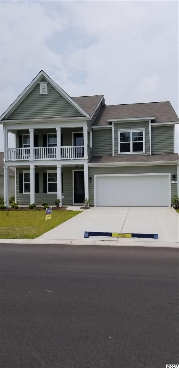 Brand new, Large, beautiful home for rent...available July 1 4 bedroom 3 bath 2 car garage...refrigerator, washer, dryer, loft 3100 heated sq ft. Hardwood floors downstairs, balcony off front upstairs bedroom Loft area upstairs between the bedrooms. Golf cart ride to beach, shopping and restaurants.