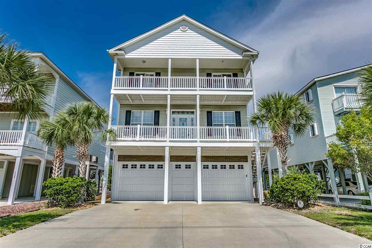 This beautiful raised beach home, partially furnished, with 5 bedrooms and 4 baths is four homes from the ocean, with a partial ocean view from the front porch!  An enclosed garage helps keep the salt off of your vehicles, and there is a pool and hot tub for your enjoyment after a day on the beach. This newer home offers something many of the homes in the area don't...storage and closet space.  The main floor is an open floor plan with the kitchen open to the dining area and family room, and there are two additional bedrooms, a full bath, and front and rear large balconies.  The kitchen is large with granite counter tops and plenty of cabinet space.   The top floor features a huge master suite with it's own kitchenette, large walk-in closet, and bathroom with both a shower and jetted tub.  There are also two additional rooms on the top floor with their own full bathrooms.  The master bedroom and one of the guest rooms have access to the third floor large balcony.  This home would make a great primary residence or vacation home, or an incredible rental property, so schedule a showing with your agent today!