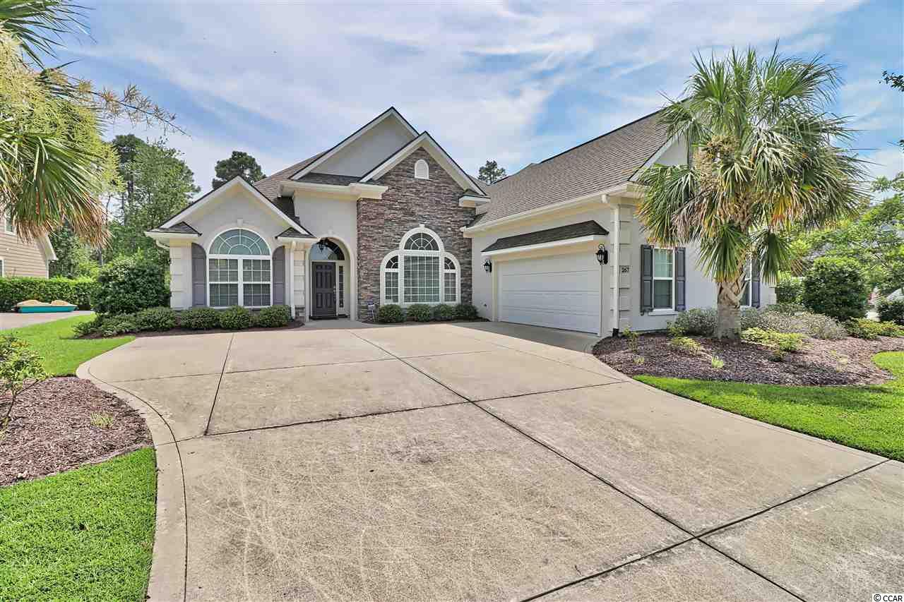 This 4br/3/5 bath home located in the prestigious Plantation Lakes community in Carolina Forest shows like a model and is in absolute mint condition.   From the moment you enter the foyer of this beautiful home, you are greeted with an open floor plan, 12 ft. ceilings, and hardwood floors running throughout the entire home(with the exception of the bathrooms).    There is plenty of room for your family to spread out in the spacious family room which features a gas fireplace, ceiling fan, and a double tray ceiling with crown molding.    As you enter the kitchen you are met with granite counters, custom cabinets, stainless steel appliances, a gas range, all open to a large breakfast nook and breakfast bar.    This beautiful home also offers a large formal dining room.     Walk into your master suite which features a double tray ceiling, crown molding, ceiling fan, double sinks with granite counters, tiled walk in shower, garden tub, and a large walk-in closet.     Two of the guest bedrooms are located on the other side of the home(split bedroom plan) separate by a guest bath.   The fourth bedroom, with it's own full bath, is located above the garage.   Plantation Lakes features some of the best amenities for it's homeowners in all of Myrtle Beach such as a huge community center/clubhouse, two incredible pools, day docks for your pontoon boat, playground, tennis courts, and much more.    After a long day spent at the pool or the beach, come home and relax on your screened porch overlooking your super private back yard with noone located behind you.    An additional patio awaits you outside as well with a gas grill line already in place.     Some of the other great features of this beautiful home include:   crown molding located almost everywhere, tankless water heater, 250 gallon tank buried that services gas fireplace, gas range, and tankless water heater, and washer and dryer will convey with the sale.    This home's condition is hard to match.   Once you close, move right in and start to enjoy Myrtle Beach living.....and the furniture in this home is negotiable.