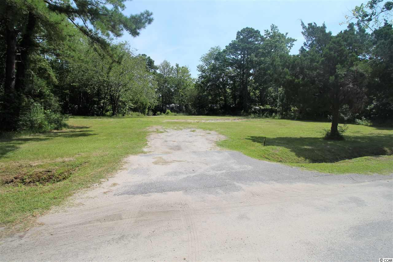 Adjacent lot 9 is also available for sale.  Can build single family home or manufactured home. Lot is cleared and backs up to small pond with dock.
