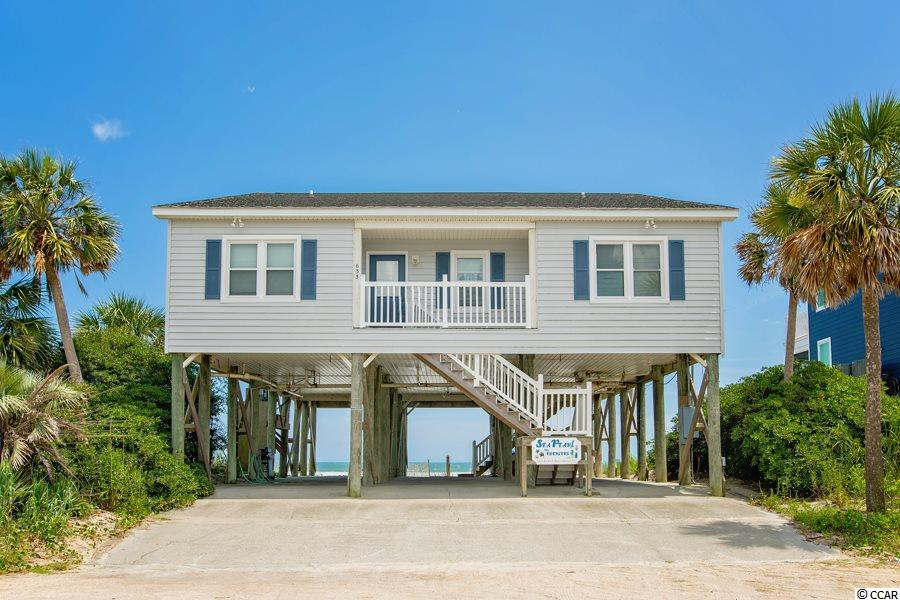 Sea Pearl is a four bedroom/four bathroom oceanfront beach house with amazing views of the Atlantic Ocean and Garden City Beach.  With large bedrooms, large bathrooms, and an open concept floor plan, this beach home has a desirable layout at an affordable cost. Spend your days on beach and your afternoons in the shade on the 11 x 42 covered porch which faces the ocean. With all windows recently replaced, and newly constructed bulkhead behind the home, this fully furnished property is the lowest priced oceanfront home on the South end of Garden City Beach available for sale.  Please call the listing agent, or your Realtor, to schedule a showing before this property passes you by...