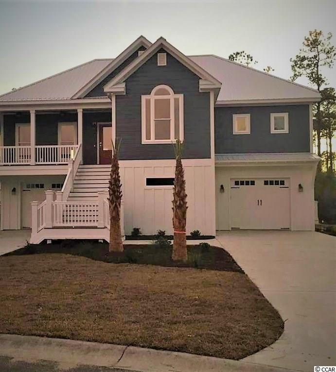 Large 2500 heated sq. ft. 4 bedroom 4 bathroom Fully Enclosed Raised Beach home to be built in Surfside Beach! If your tired of looking around Surfside trying to find something larger and newer than the typical 1500 sq. ft. 1960's style ranch build then look no further! This home will have it all as all of your primary living space is located on one floor with the addition of a guest suite on the ground floor while still maintaining garage space for three cars and a golf cart with storage space still left over that would be larger than a typical garage! Outside Construction will be prestained Hardie Concrete Fiber Board Siding with the composite decking and a metal roof for as close to zero maintenance as you can find for coastal living and built to the newest wind load and hurricane build code standards and with the inside including LVT flooring with custom wood cabinets in the kitchen and all bath vanities and Granite tops all the way around, stainless steel appliances and lots of built in lighting!