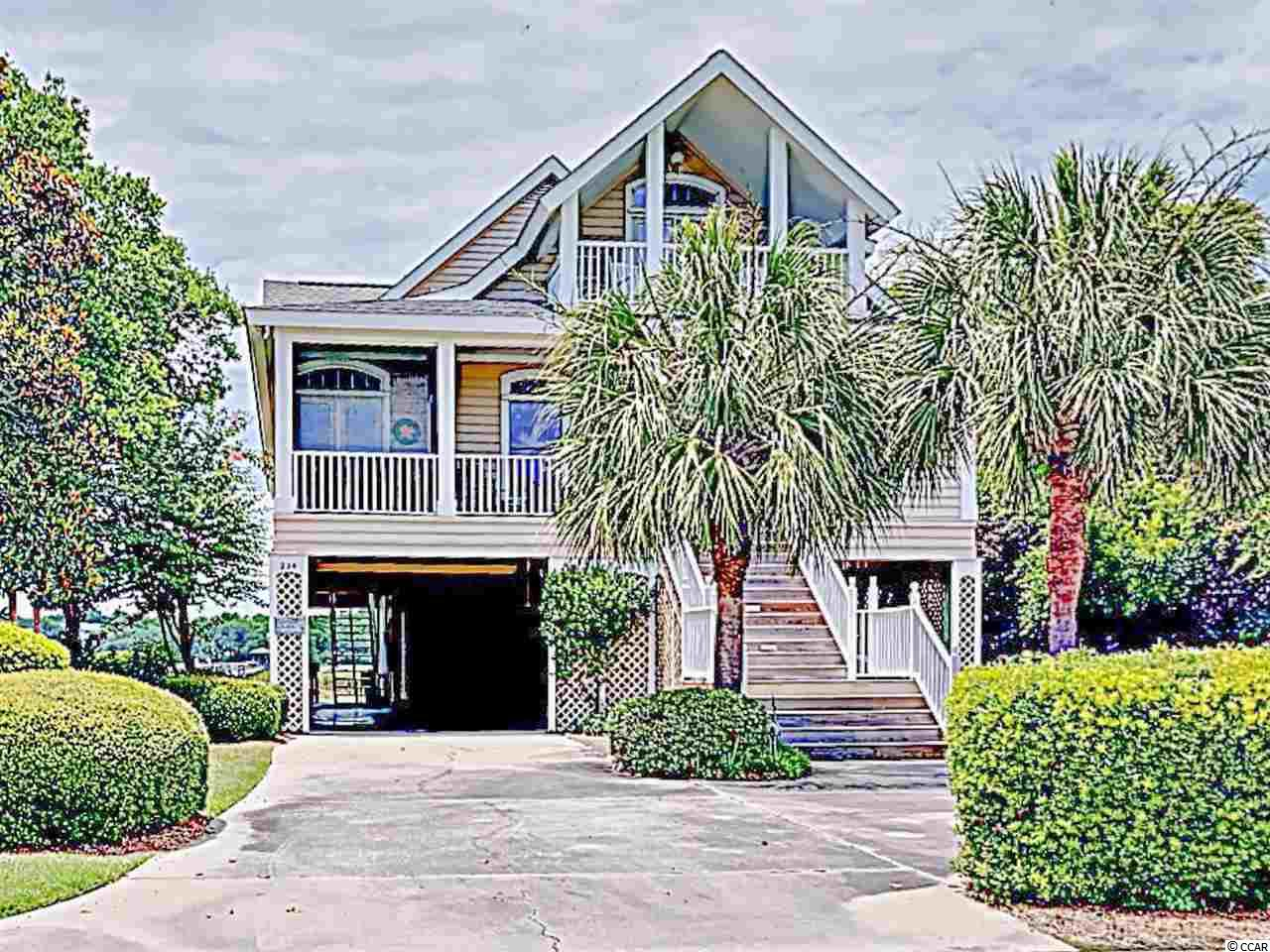 This gorgeous home is located on the creek in Inlet Point South.  It has fabulous views of creek, salt marsh and a glimpse of the ocean from the top floor porch.  The open floor plan allows great views from living spaces.  There is also a loft that is open to the large living room below. It is beautifully furnished, and the kitchen was renovated just a few years ago.  Currently set up as a 4 bedroom home, it has a 5th bedroom that is currently being used as a family room/ office.  Enjoy all of the amenities including a large 65' UHD flat screen in the living room, with surround sound, multiple porches, fireplace, bar, enclosed outside shower, fish cleaning sink, covered dock and floating dock on the creek that is only shared with one neighbor.    The Inlet Point South Community includes a private boat landing in Pawleys Creek, swimming pool, private access to Litchfield Beach, and guard gate at the community entrance.   The home has been used and loved by the owners for many years and shared with a great business of loyal repeat renters in the summer.  Rental income is available by request though The Dieter Company.
