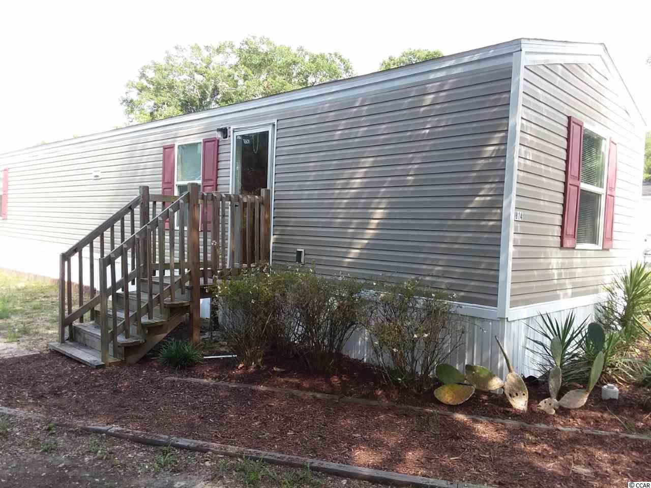 Perfect location for a beach retreat.  This two bedroom one bath home is east of Hwy 17 and a short golf cart ride to the ocean.  The mobile home is only 4 years old and comes with deeded land.  There is no HOA.  Storage building on the property conveys.