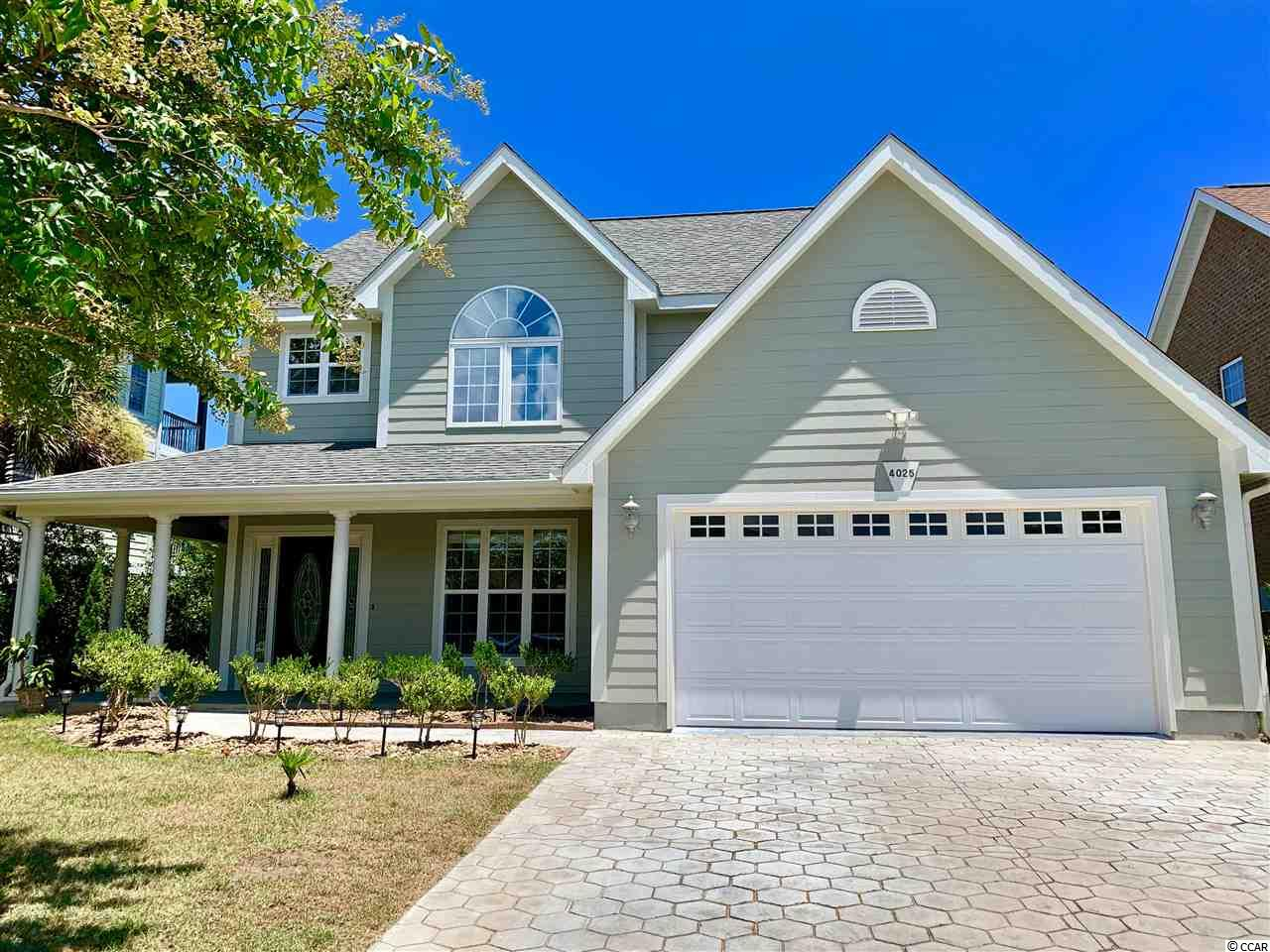DON'T MISS THIS CHANCE TO PURCHASE IN THE BLUFFS ON THE WATERWAY.  This home has a tall entry way foyer, private dining room, family room with see through fireplace, granite kitchen, stainless appliances, ceiling surround sound, whirlpool tub, tall ceilings in the bedrooms, large private back yard, wood flooring, ceramic tile flooring, and you get to pick the new bedroom carpet colors through a flooring allowance.  This neighborhood has boat storage, boat ramp, tennis courts, club house, swimming pool, and is located perfectly in Carolina Forest near shopping, restaurants, medical, and of course just a few minutes to the beach.