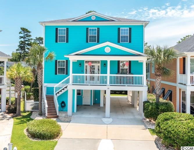 This is an outstandingly built and upgraded raised beach home, East of 17 Business in the heart of Surfside Beach.  Take out the worry of an HOA or being in a floodzone, South Beach is a one-of-a-kind neighborhood. This home sits at the end of the cul-de-sac providing privacy, yet steps away from the heart of Surfside Beach and close to the beach.  This home was freshly painted and newly landscaped with low maintenance shrubs and trees. Take the elevator from the ground floor to the main floor or bedrooms, or use either staircase to get upstairs. Walking through the front door there are refinished real wood floors sparkling, to the right, a formal dining room with a beautiful double tray ceiling and unique light fixture.  The dining room opens to the living room with a fireplace in the corner, and is open to entertain from the kitchen. Granite countertops, a custom island with a built-in wine rack and wine fridge, gas cooktop, double oven, pendant lighting, and under cabinet lighting are some of the features of the impressive kitchen. Take the elevator or the motion activated lit stairs to the next floor where the owners' suite features a tray ceiling, ensuite bath with a whirlpool tub, tile shower with a rainhead and dual shower heads and jets! Two more bedrooms, bathrooms, ample storage and a large laundry room with LG washer and dryer with pedestals are here as well. The back patio is large for several different seating and entertaining areas, and completely screened.  Go down the spiral staircase (or elevator) to the outside area that is perfect for entertaining. A pool, summer kitchen, outside bar, full bath, storage, and plenty of covered parking are some of the features downstairs. The details in this home are intricate, practical, and abundant.  A new HVAC Ocean Edition unit was installed November 2018, Gutter Helmet gutters was added with a transferrable warranty so that the gutters will never have to be cleaned out again, all lightbulbs were replaced to LE